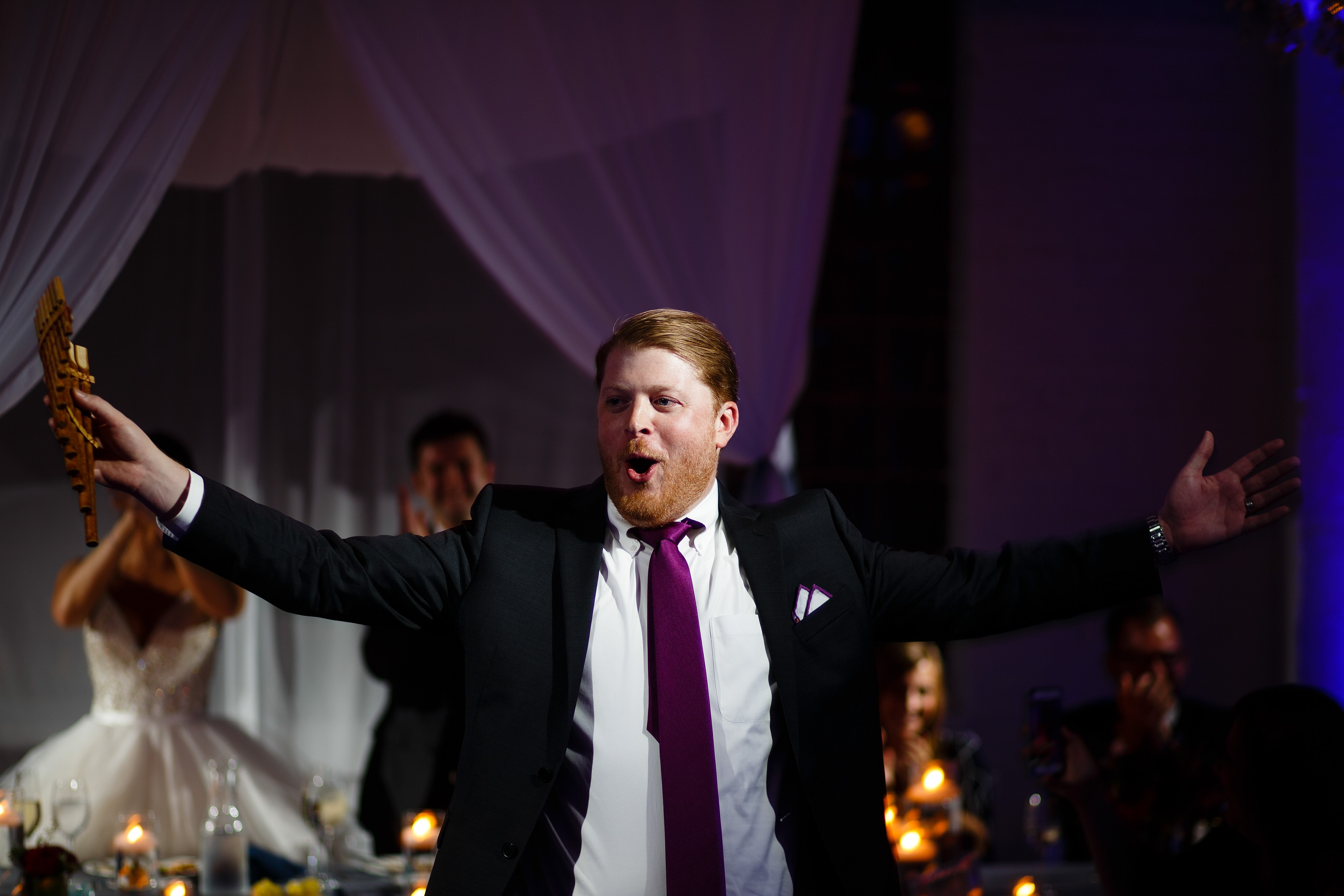 A guest cheers during a toast
