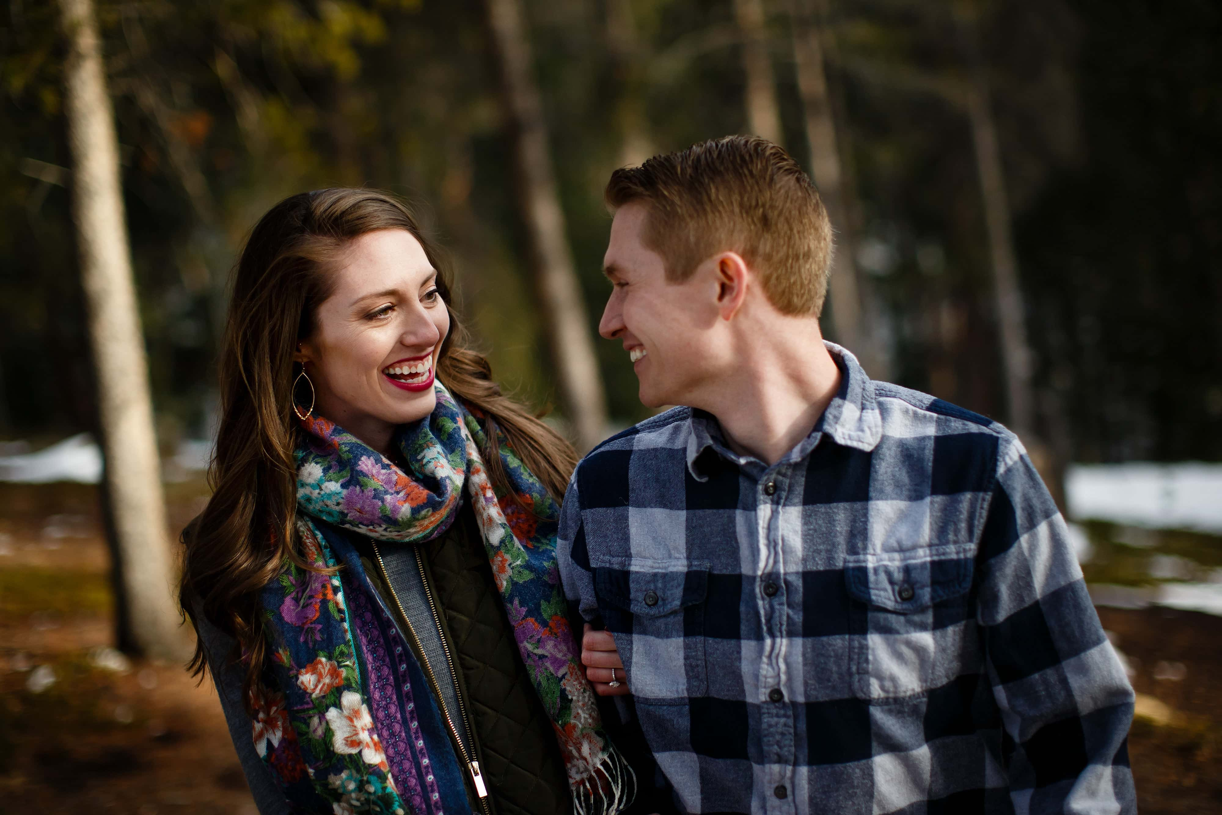Hannah and James walk in the forest during their Evergreen engagement photos