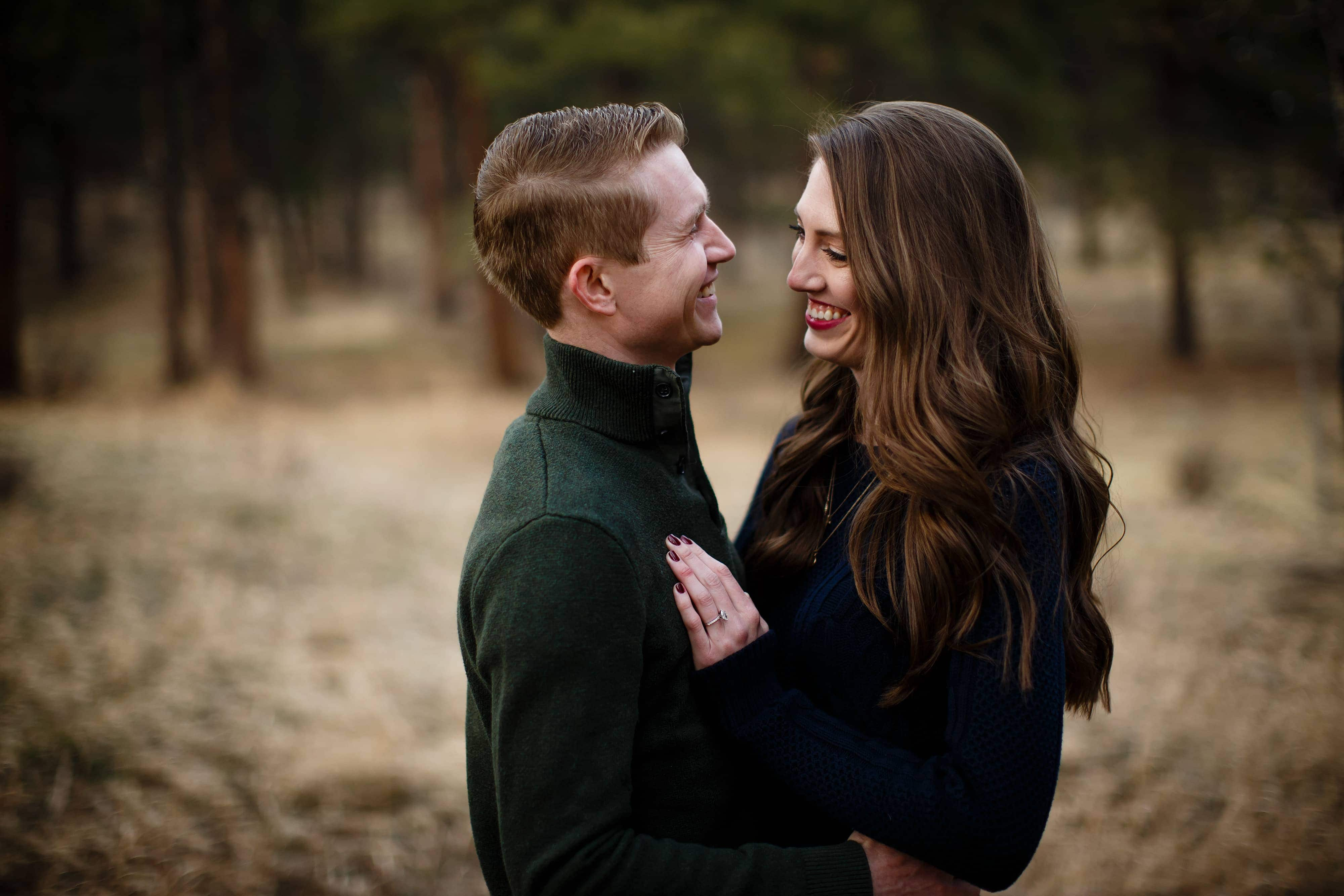 James and Hannah laugh together during their engagement session