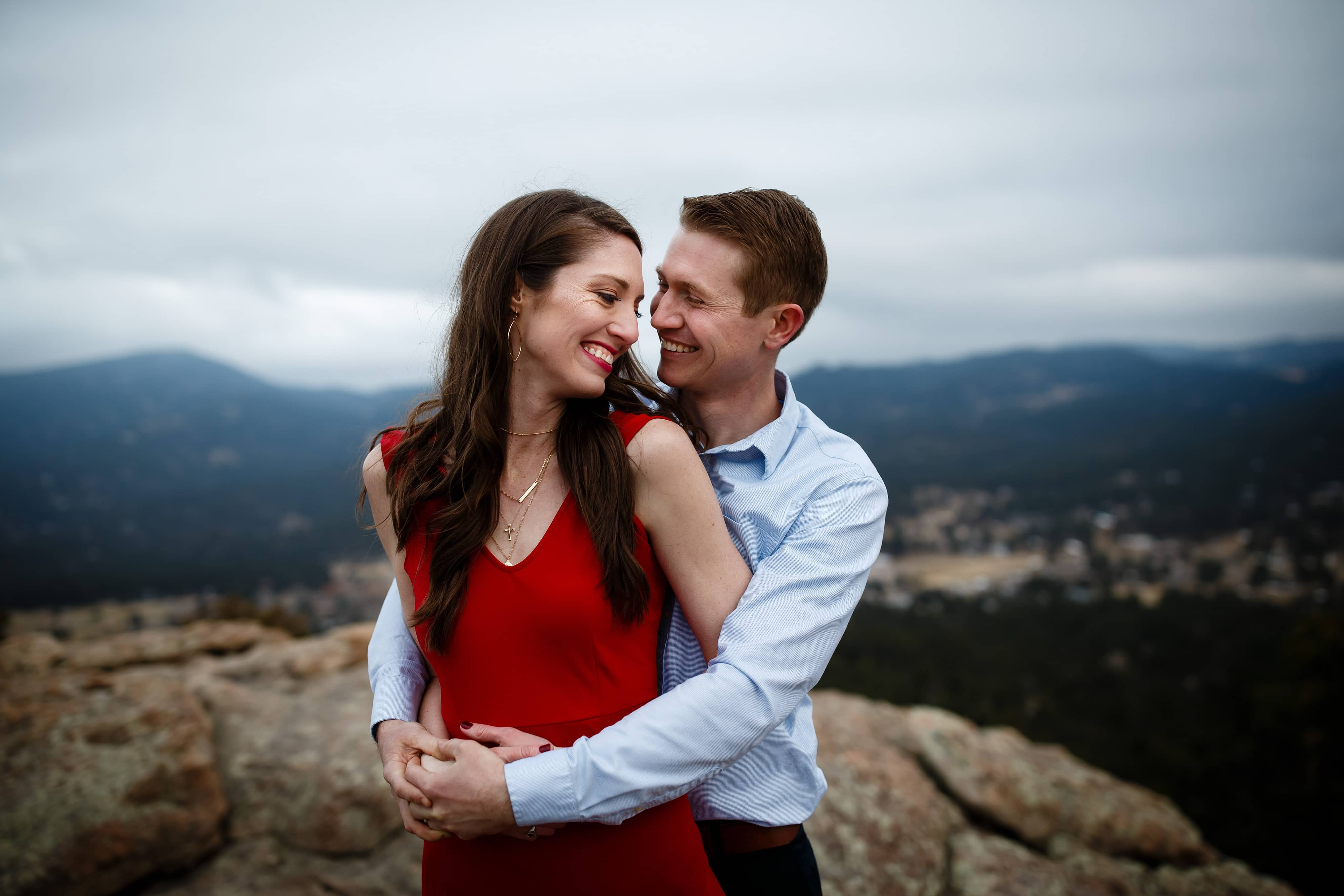 James hugs Hannah on Brother's Lookout at Alderfer Three Sister's Park during their Evergreen engagement session