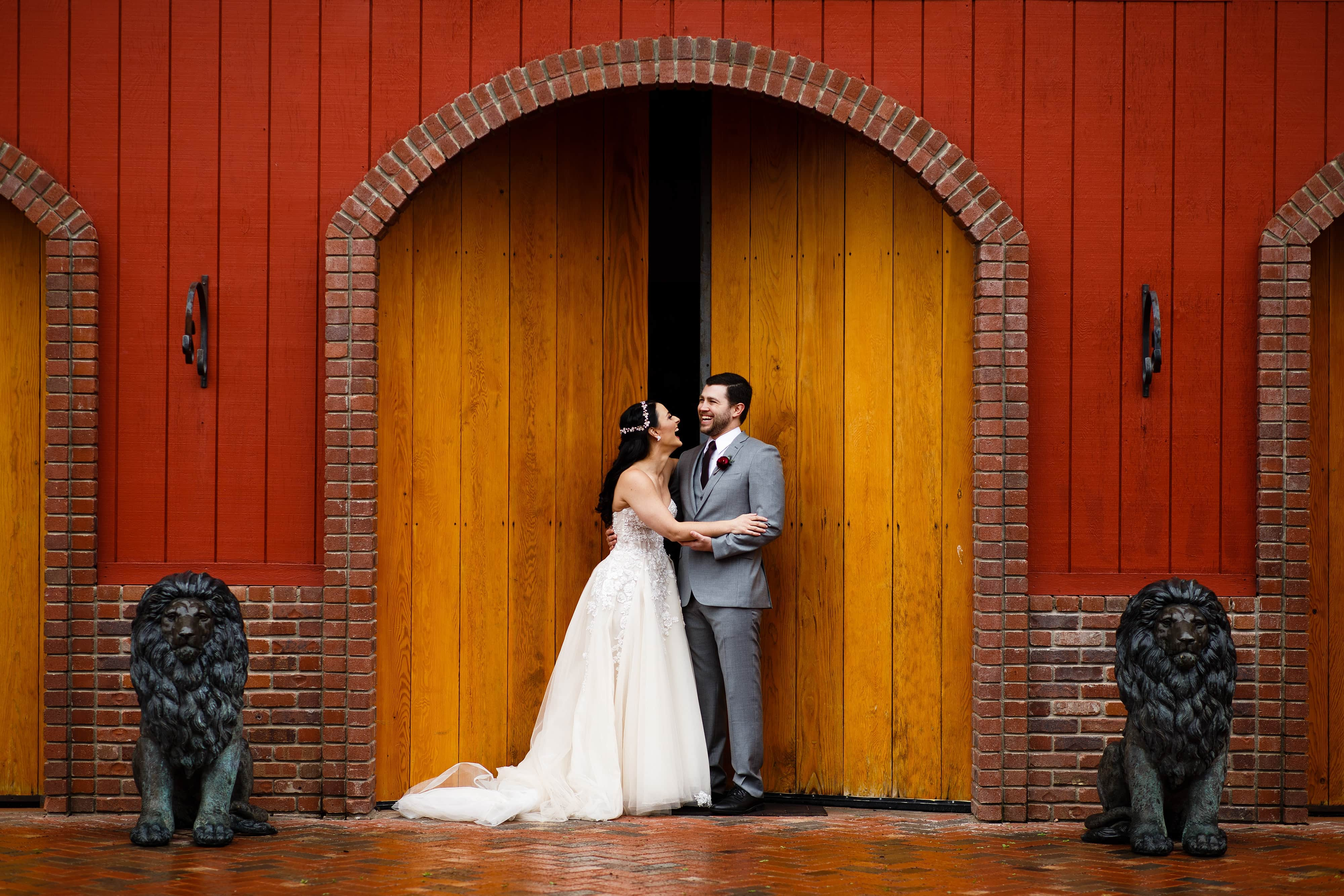 The couple shares a laugh together while posing for portraits during their Crooked Willow Farms wedding