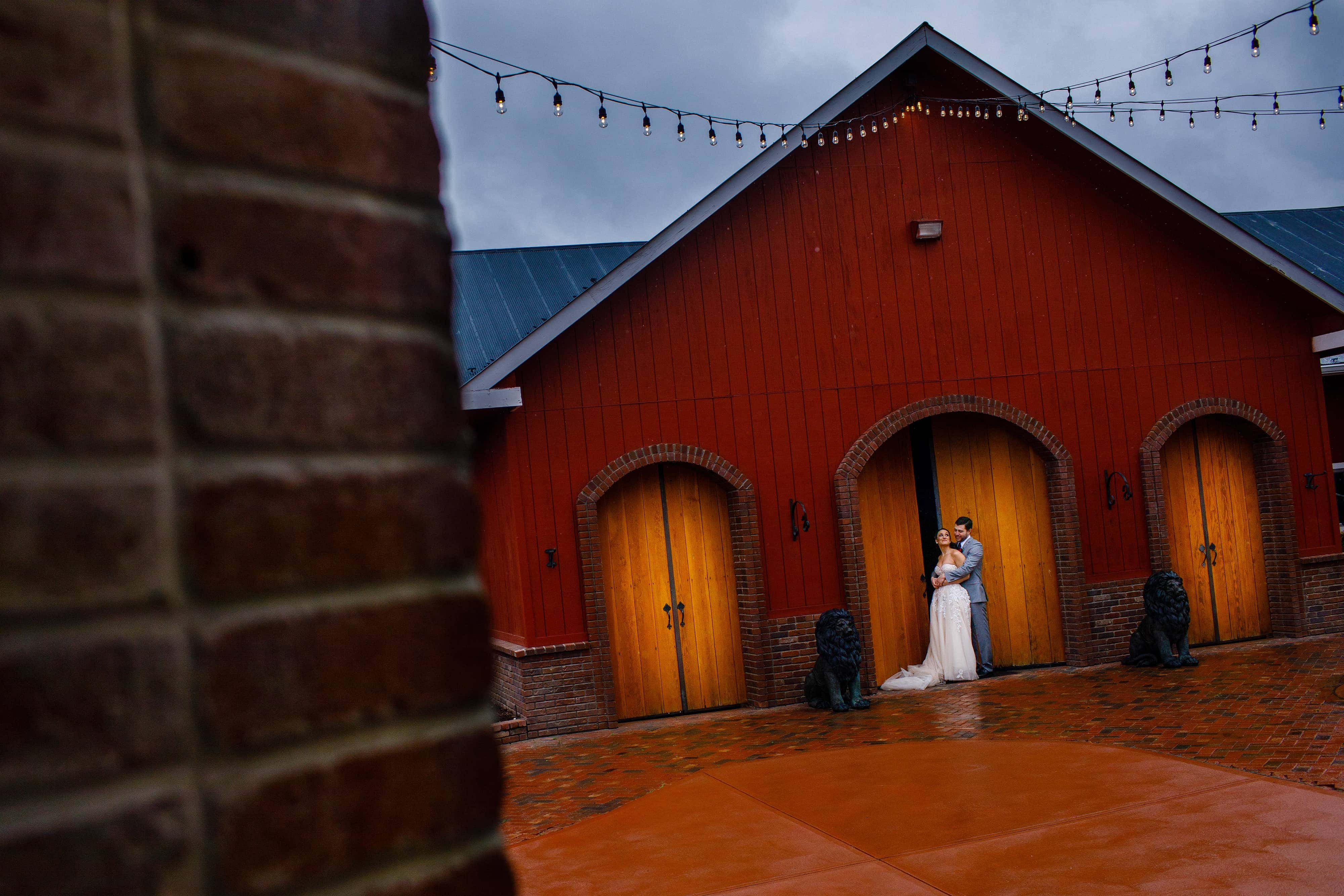Danielle and Jordan share a moment together during their barn wedding at Crooked Willow Farms in Larkspur, Colorado