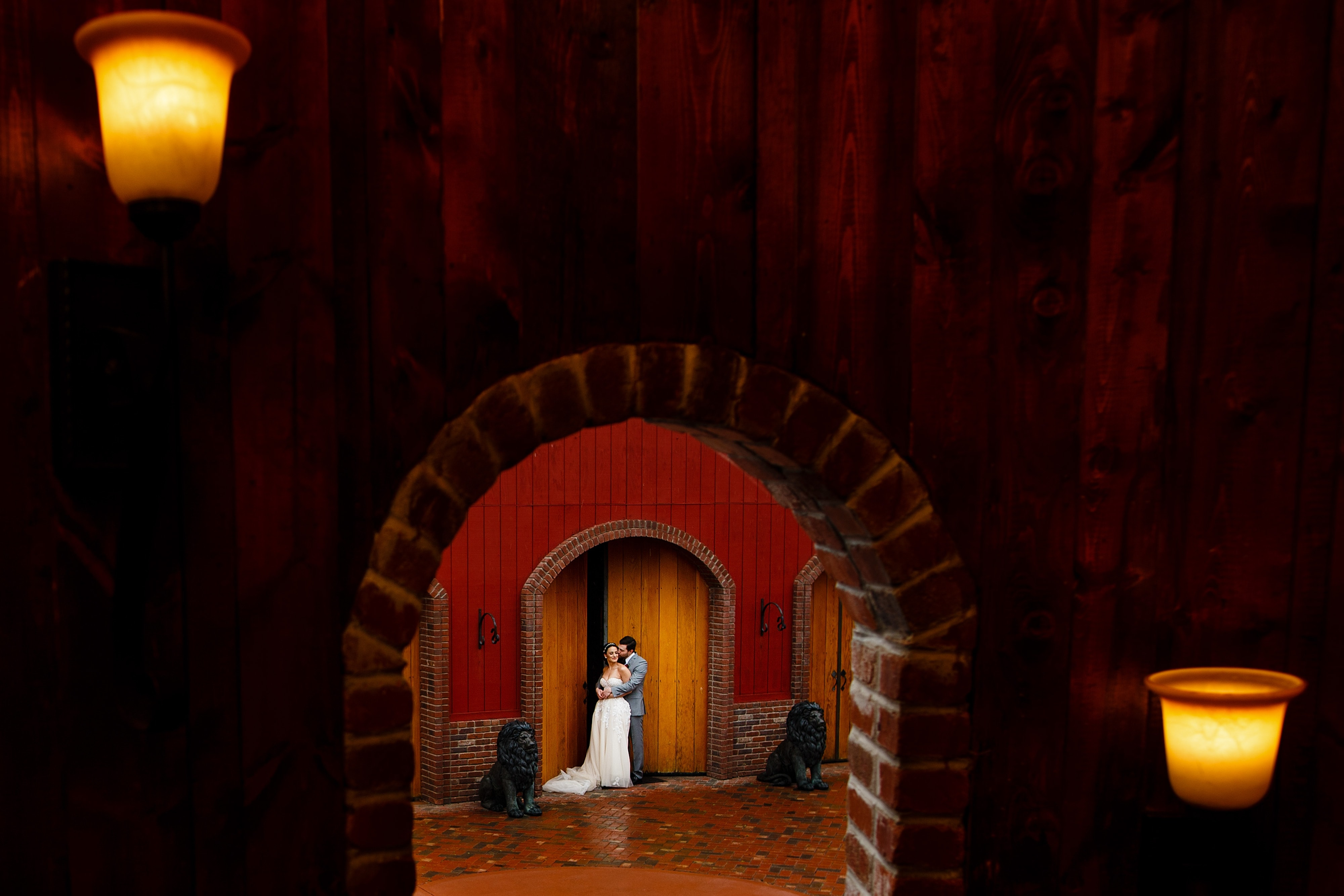 The couple is framed by the barn as they pose during their Crooked WIllow Farms wedding