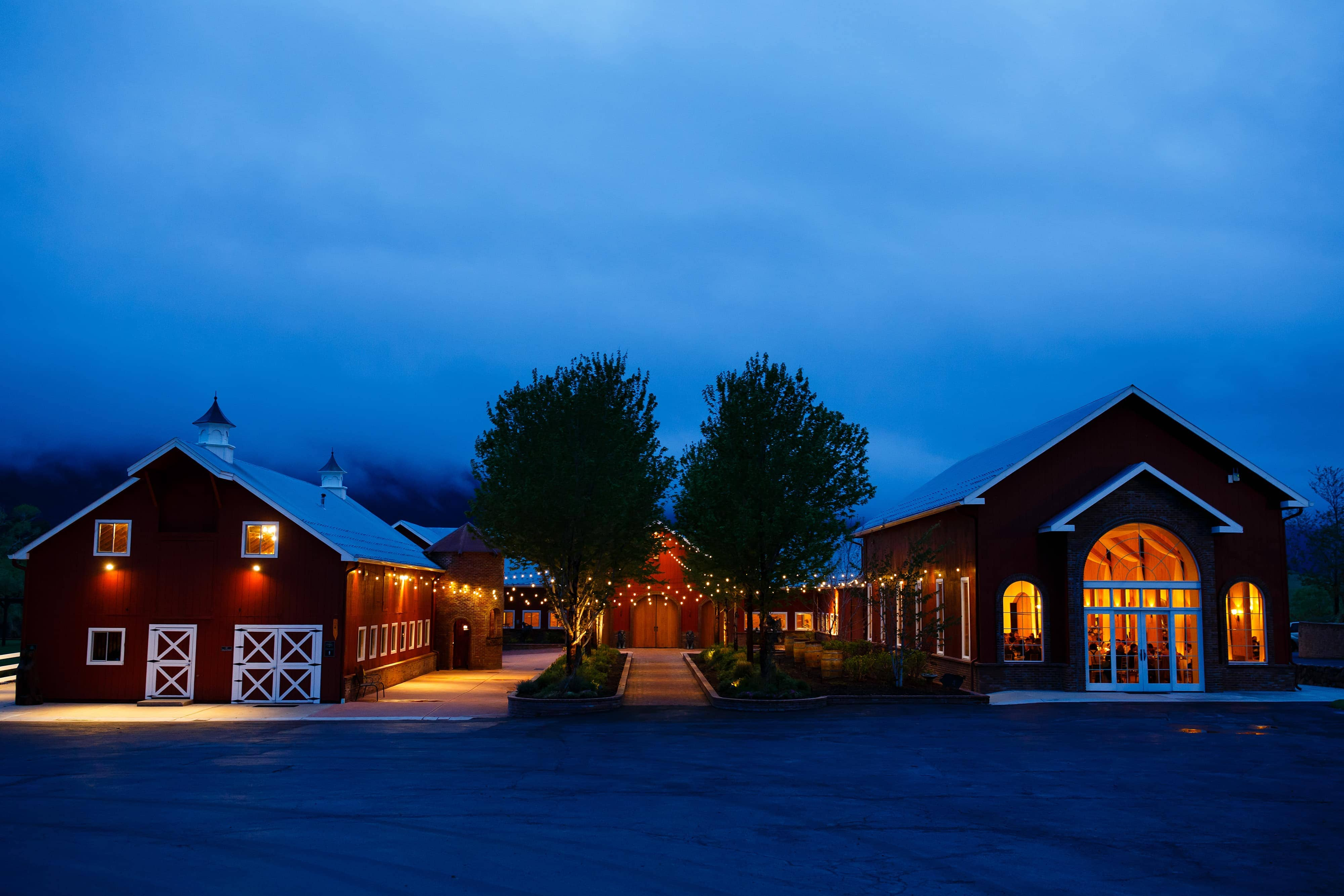 Fog rolls in during a twilight wedding at Crooked Willow Farms in Larkspur, Colorado