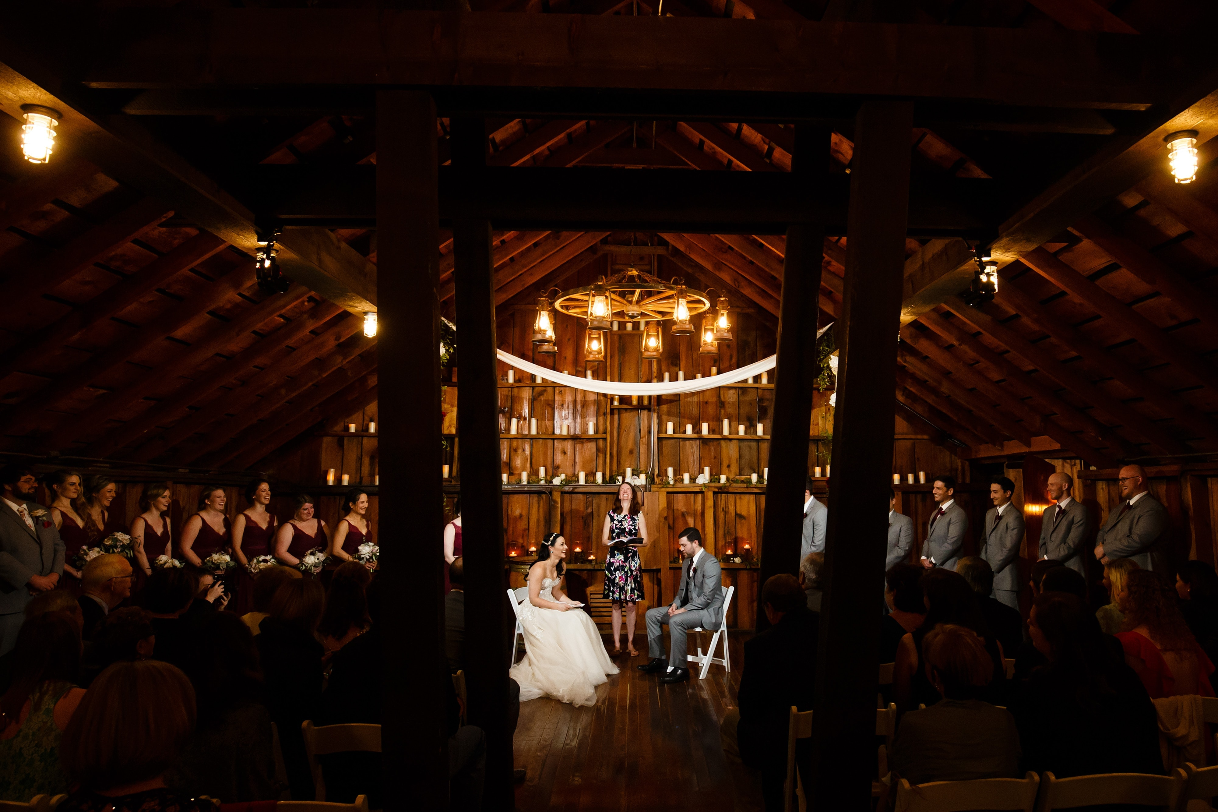 Danielle and Jordan share their vows in Lola's Loft during their ceremony at Crooked Willow Farms in Larkspur, Colorado
