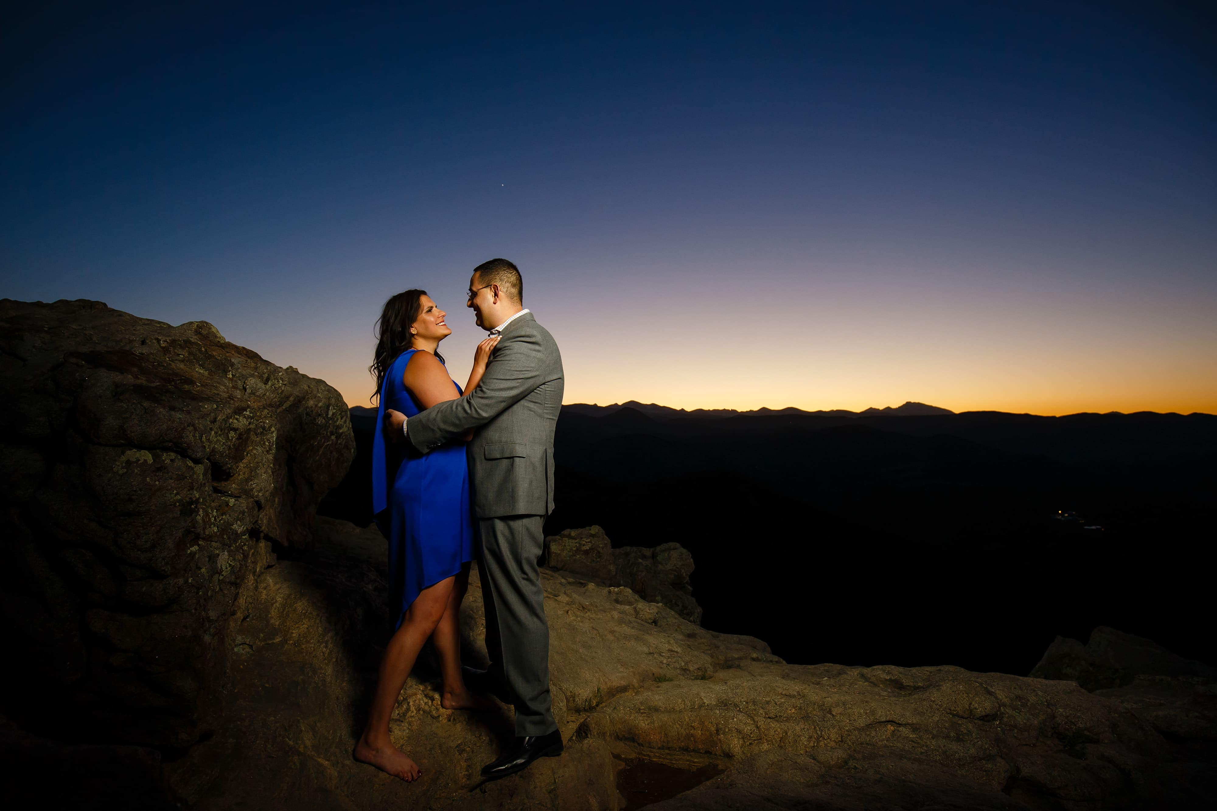 Dimitra and George share a moment while watching the sunset at Lost Gulch overlook during their engagement photos in Boulder Colorado