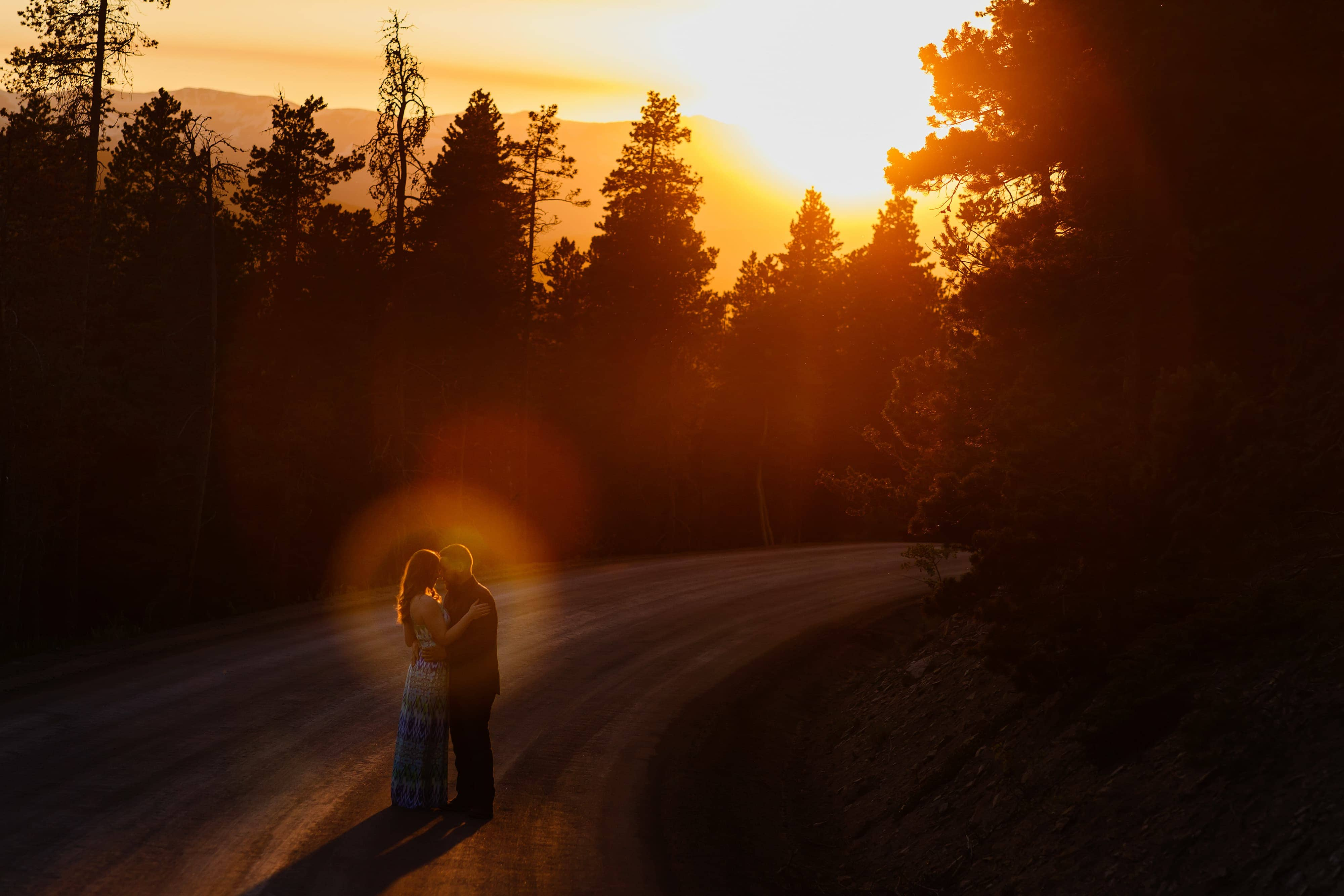 Nick and Sharon pose on Gap Road during their colorful engagement in Golden Gate Canyon State Park