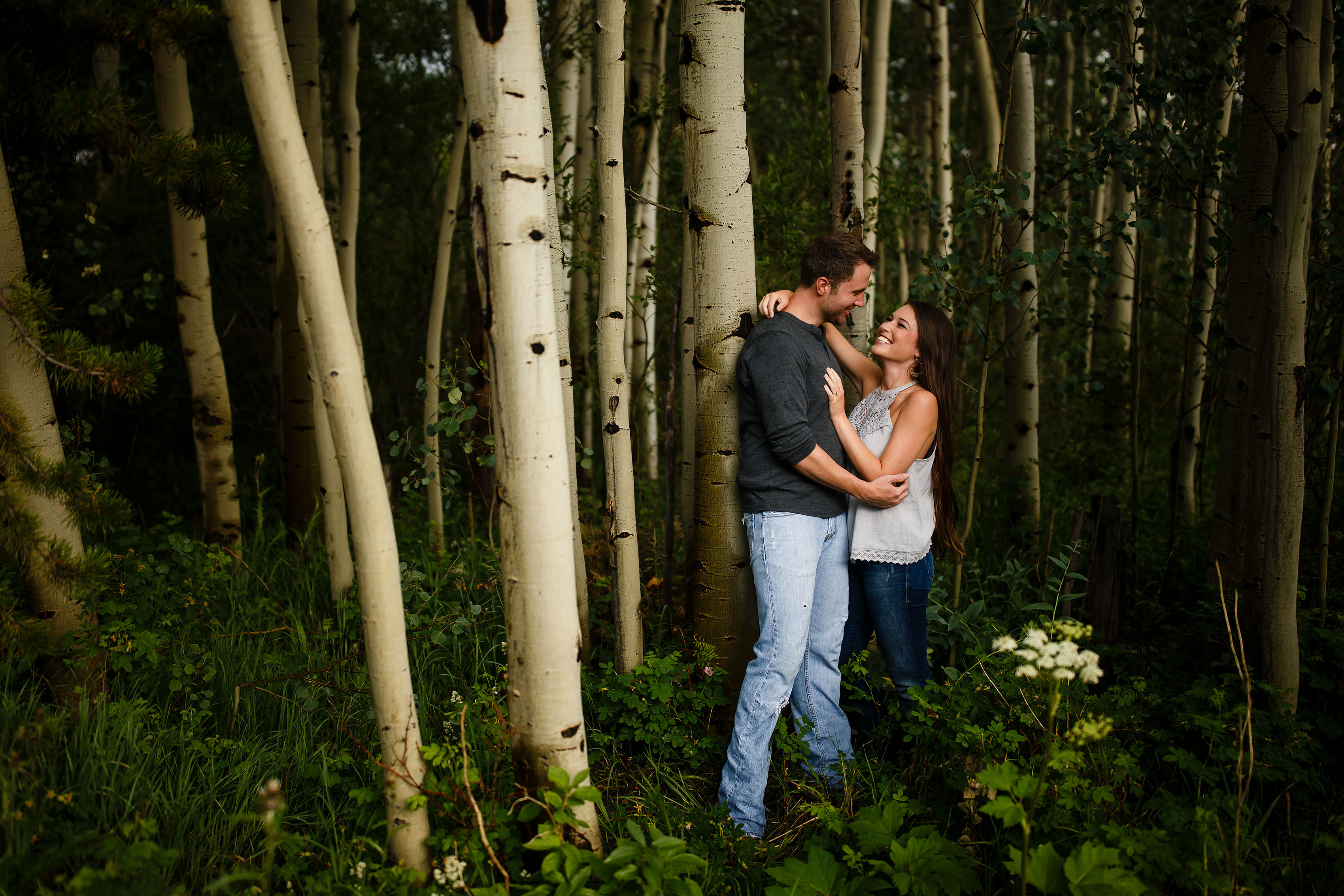 Aaron and Alesha pose in the woods at Meadow Creek near Frisco