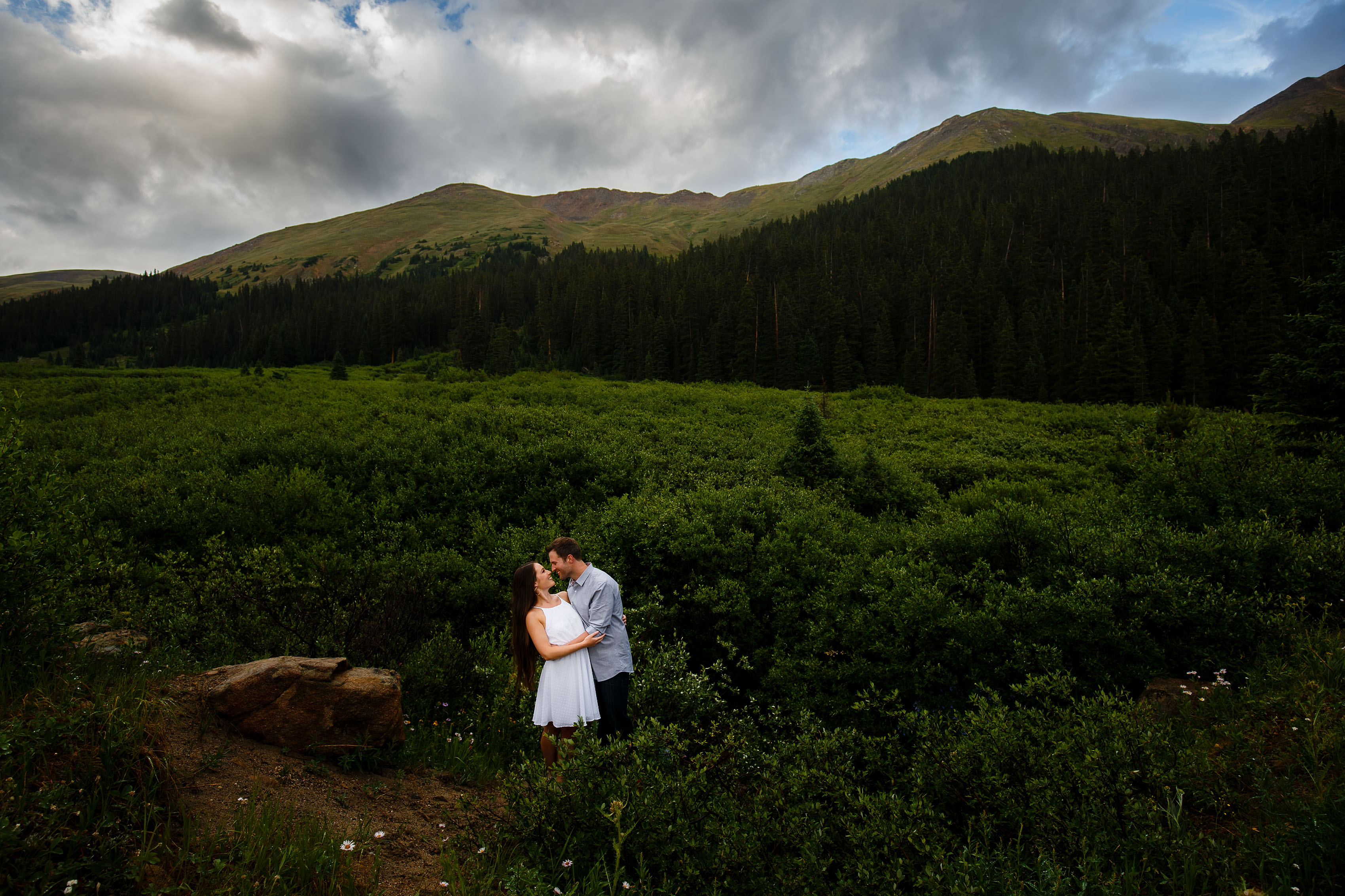 A couple poses during their summer engagement session on Loveland Pass in Keystone