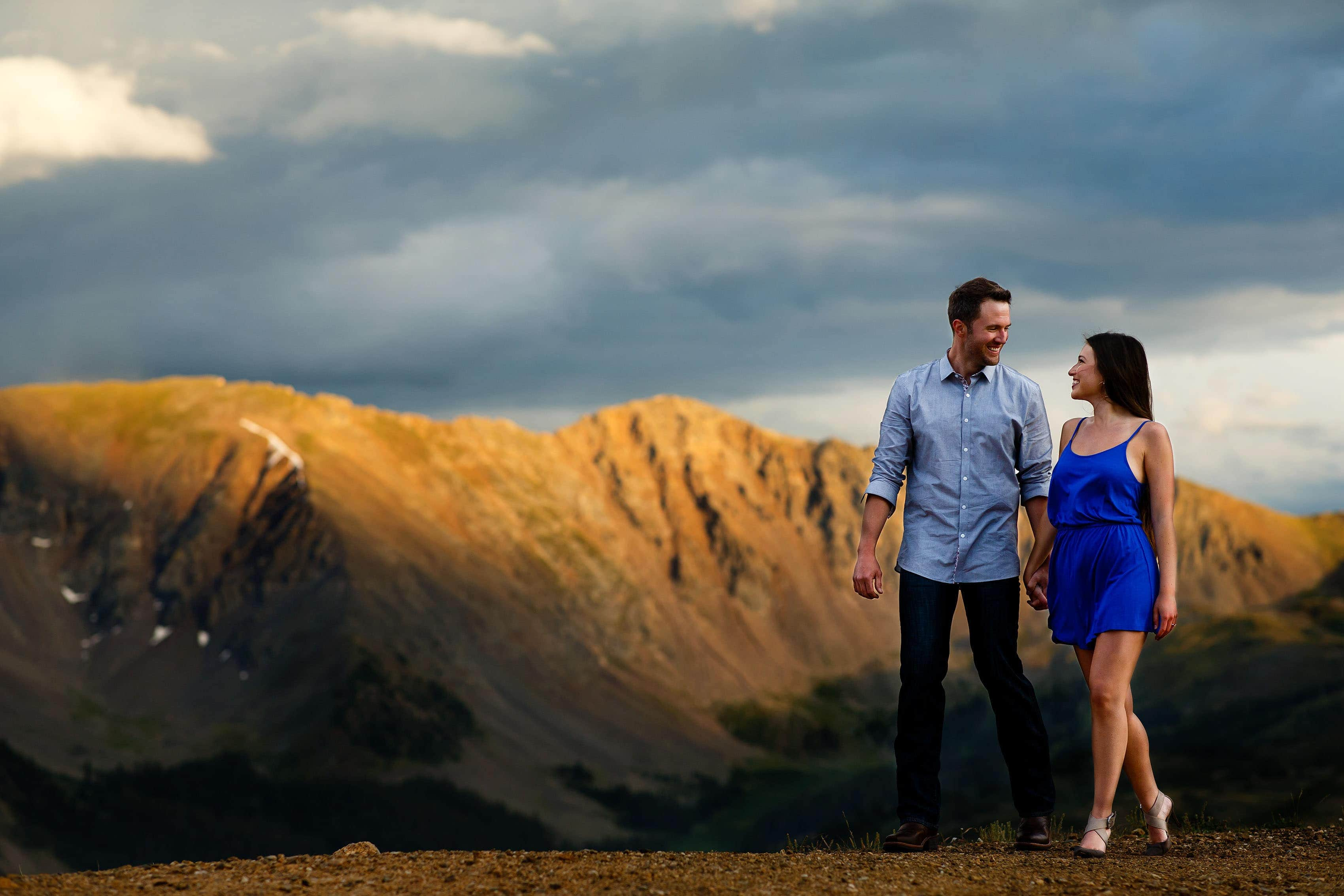 A couple walk together during their summer Loveland Pass engagement photos in Colorado
