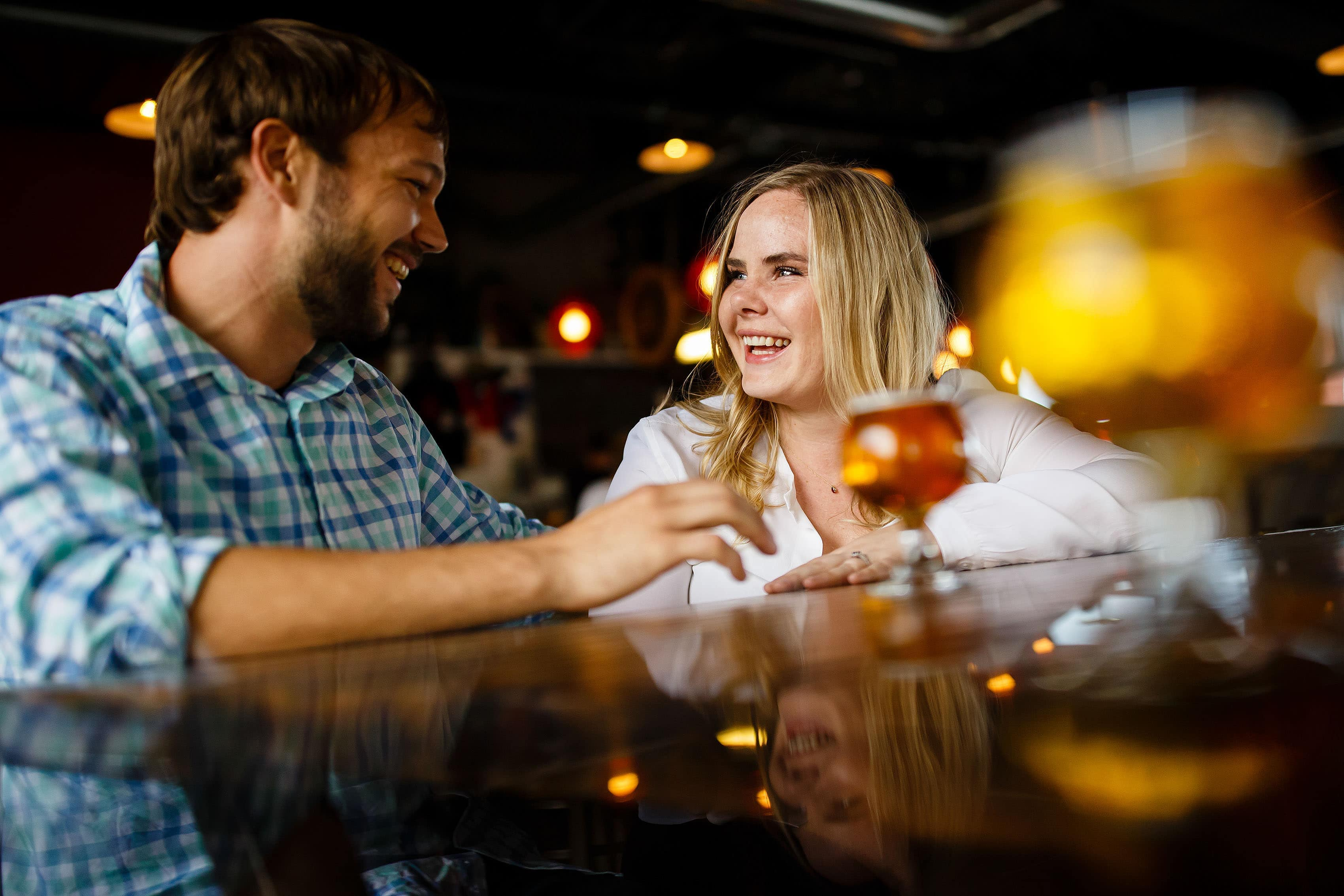 Coza and Joel enjoy a beer at Cannonball Creek Brewing Company during their fall Golden engagement