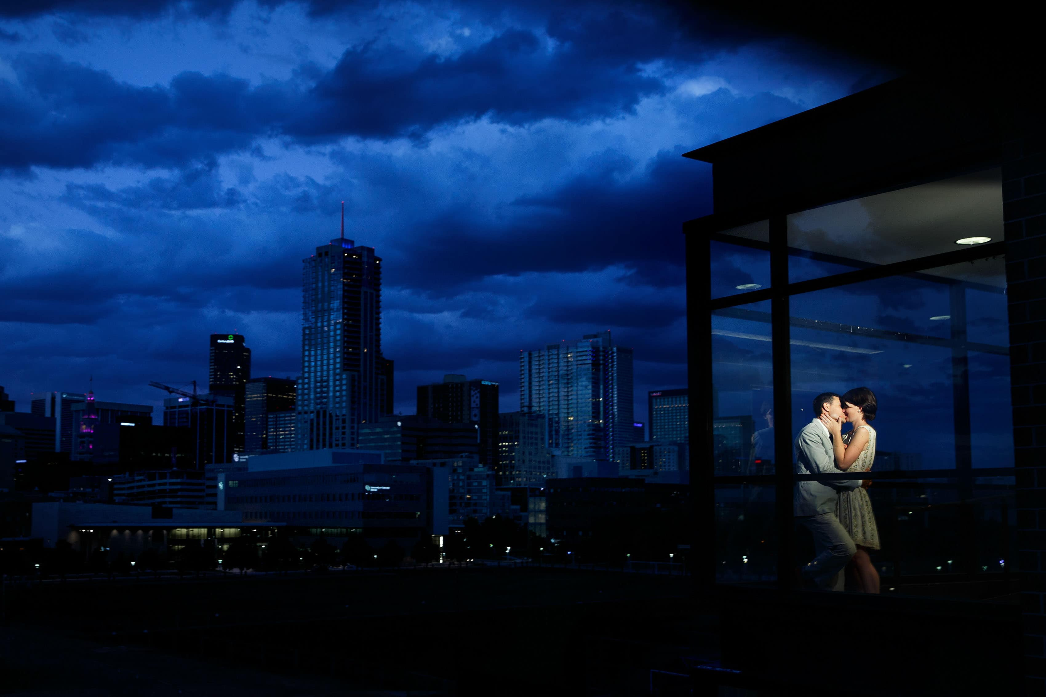 Engagement with Denver skyline on Auraria Campus