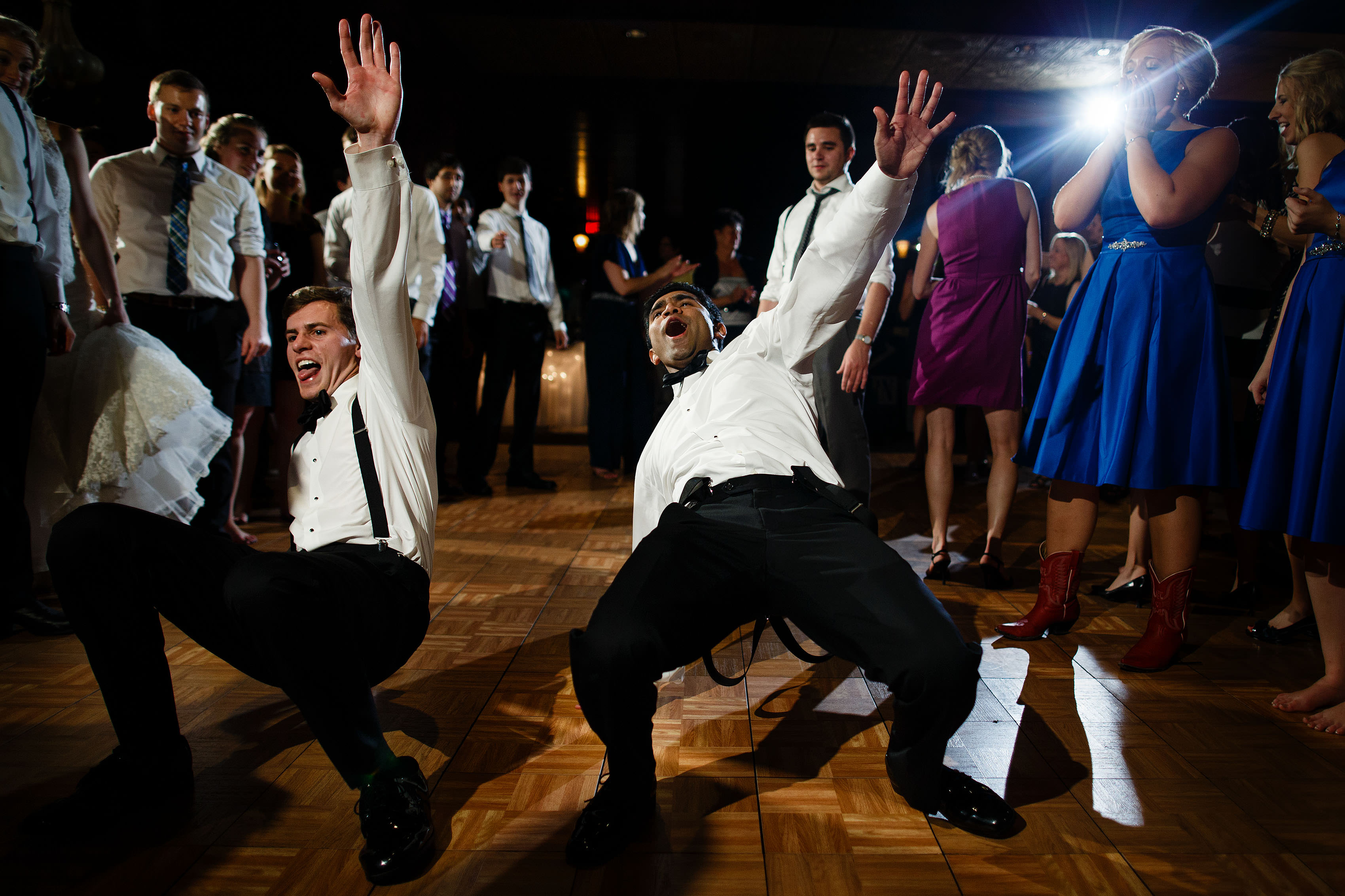 Groomsmen dance during a Trappers Turn wedding reception in Wisconsin Dells