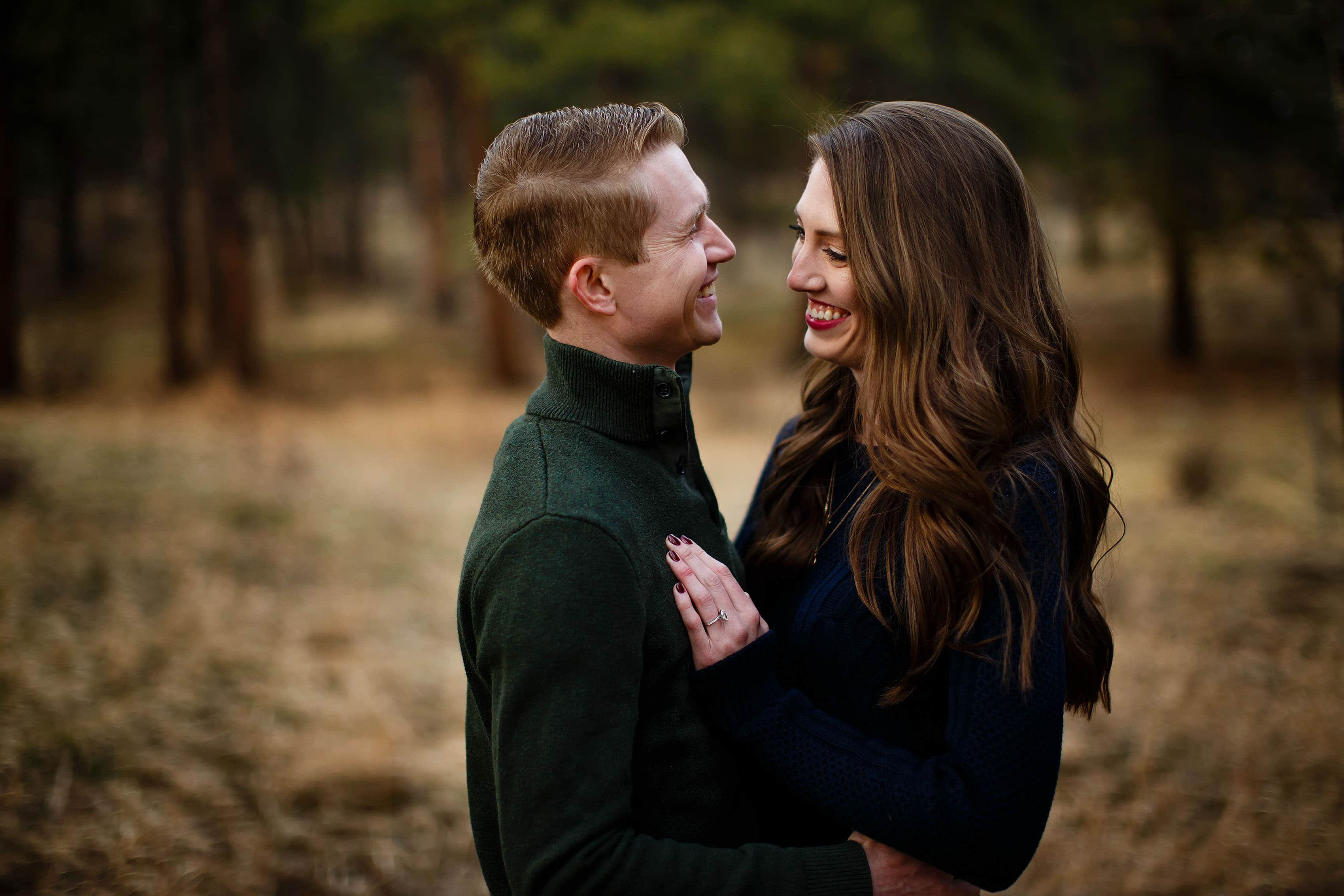James and Hannah laugh together during their engagement session at Alderfer Three Sisters