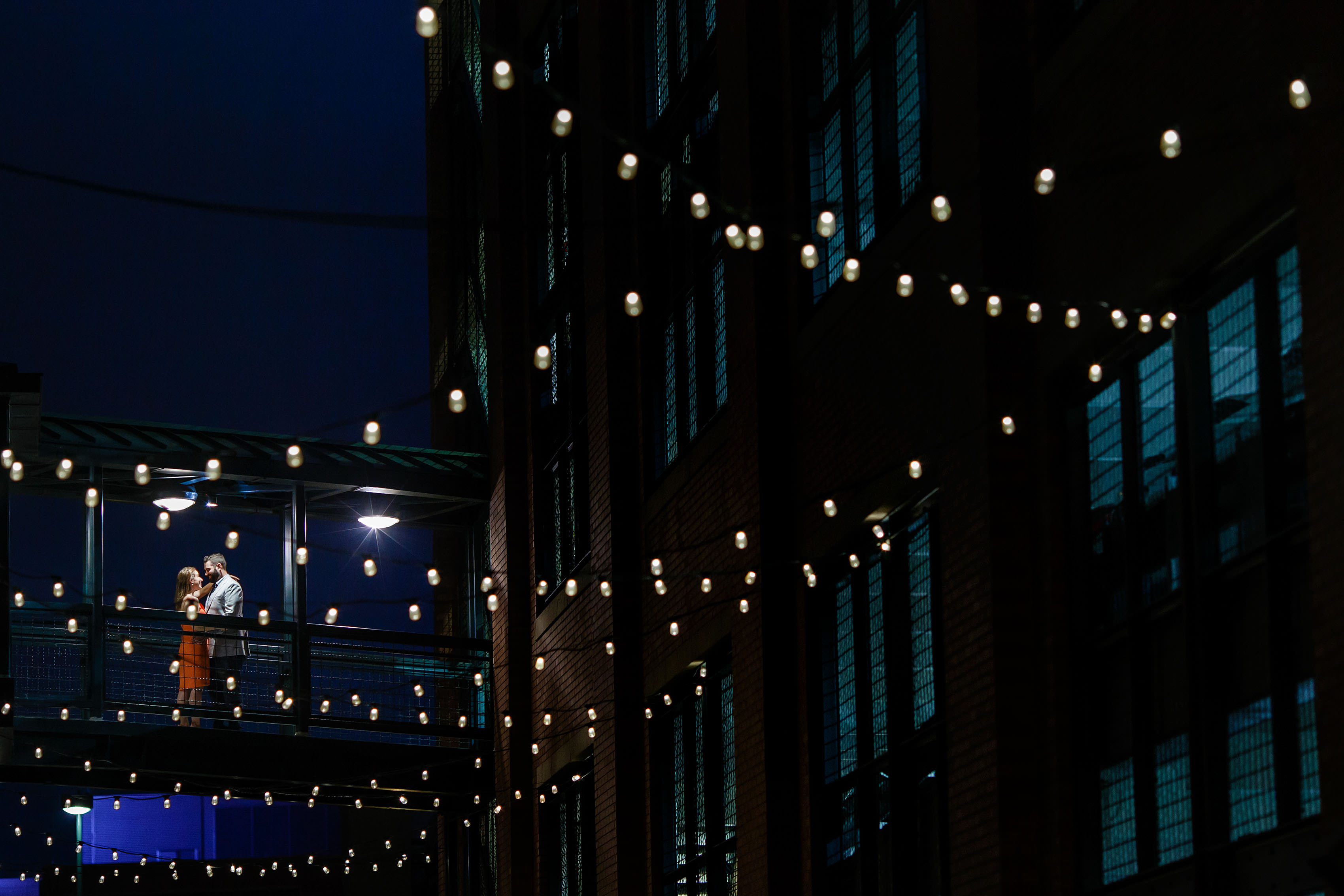 Larimer Square engagement under twinkle lights