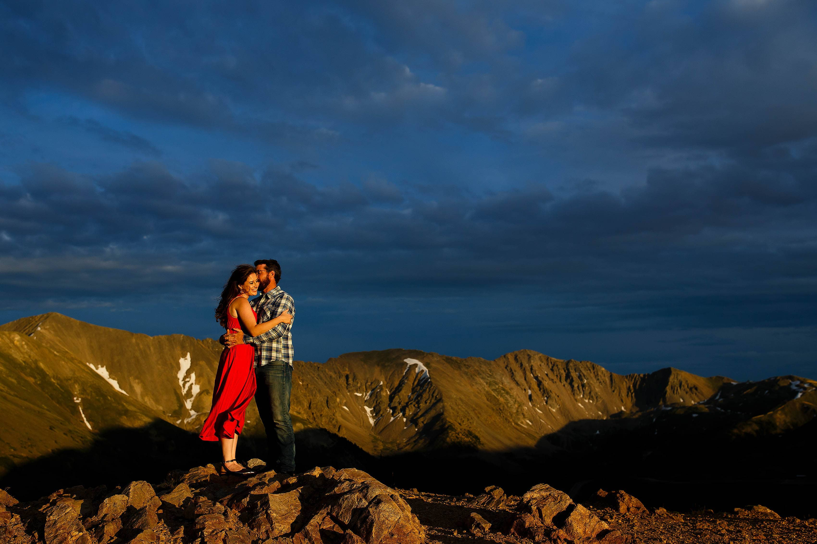 Loveland Pass engagement at sunset in a red dress