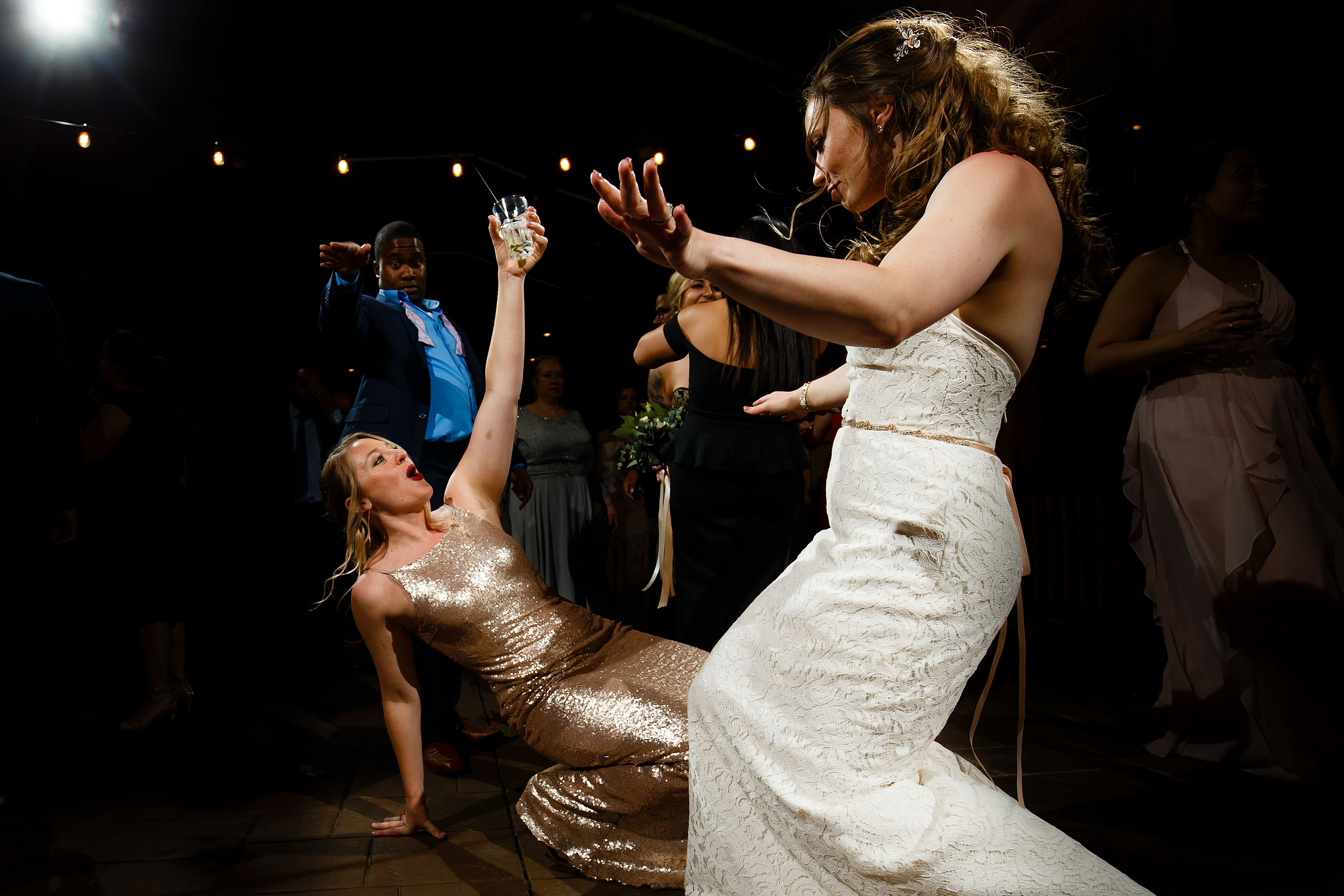 The maid of honor dances with the bride at a Breckenridge TenMile Station wedding