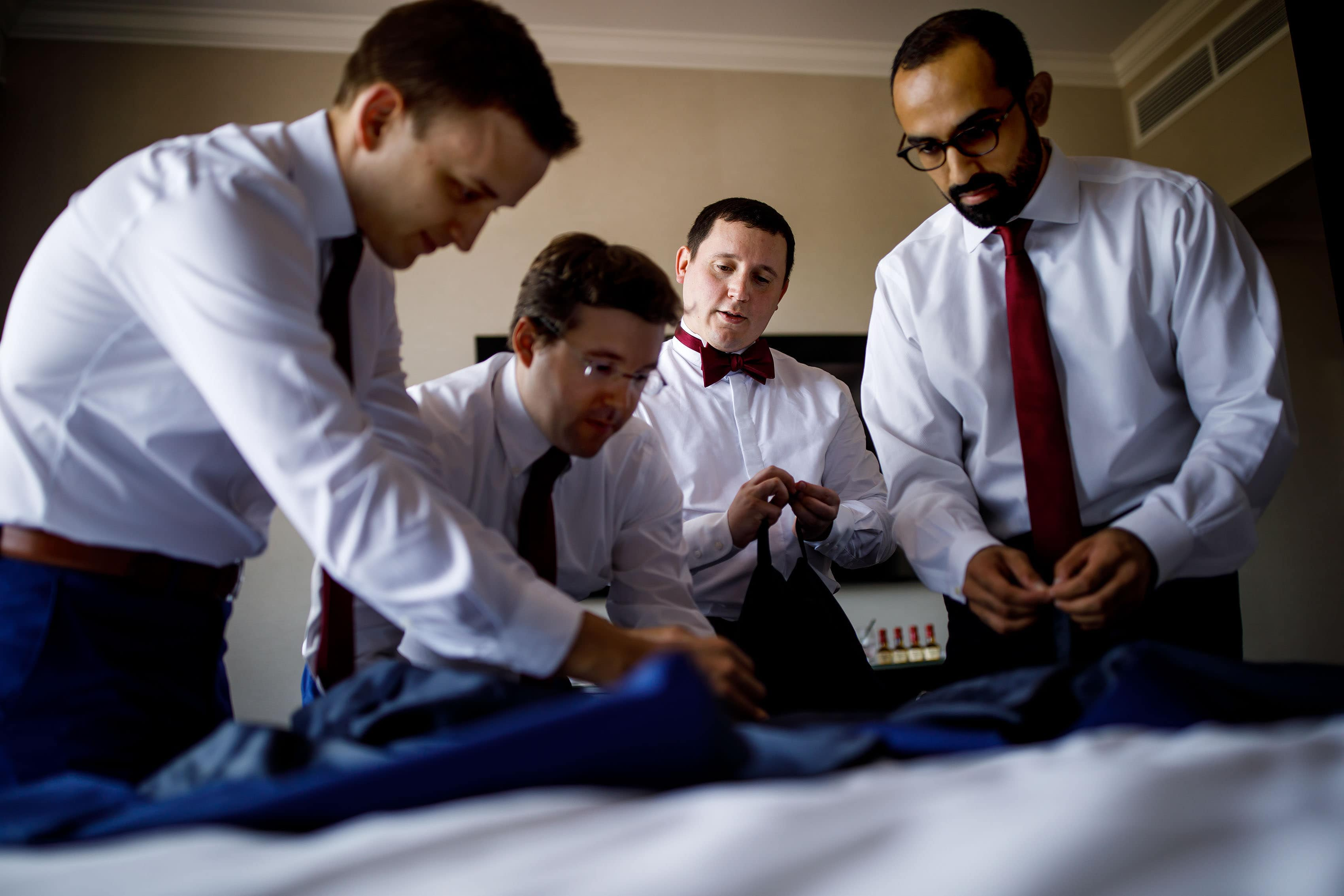 The groom and groomsmen get ready at La Banque hotel