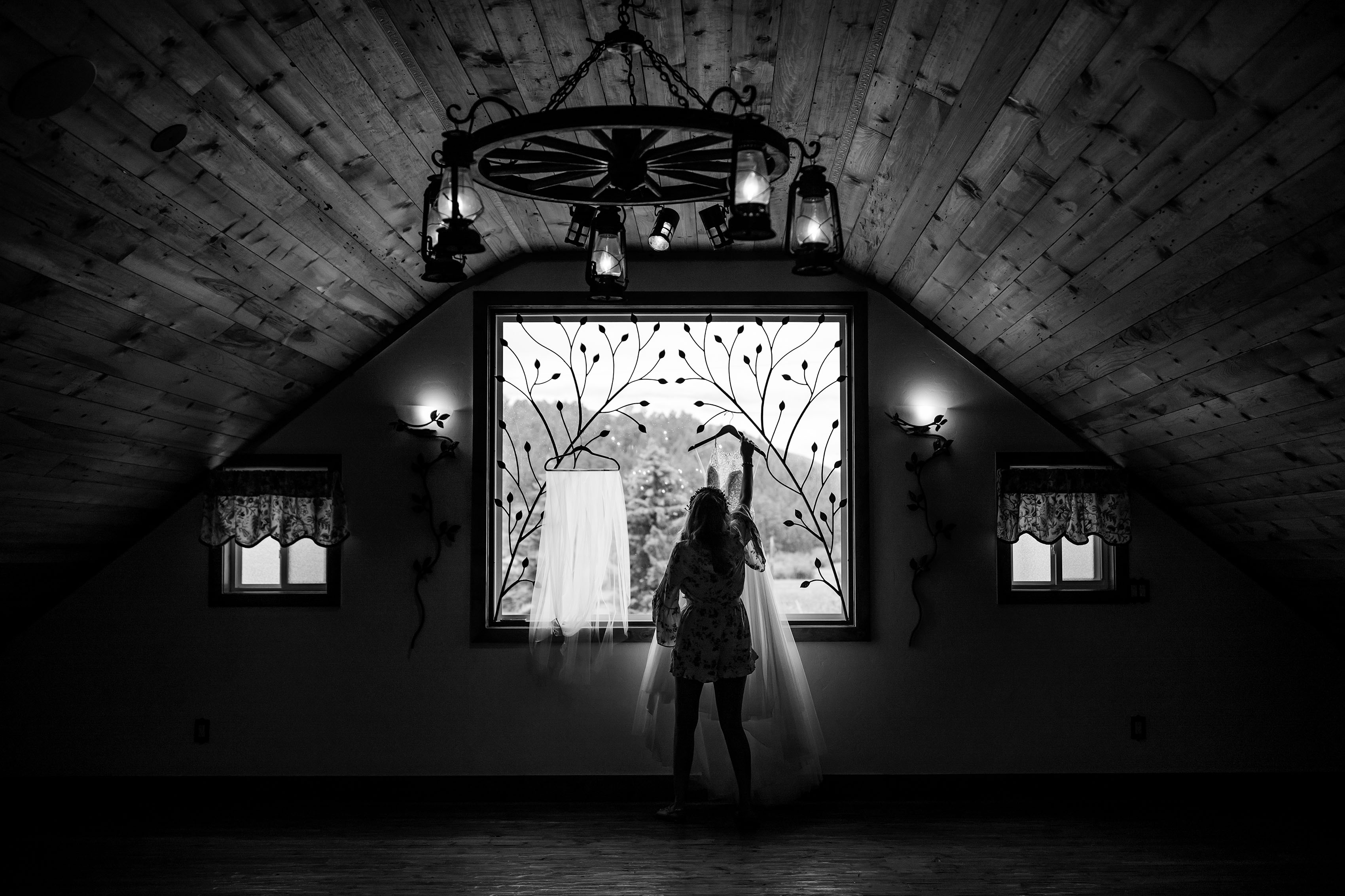 The bride hangs her gown in the barn during her Deer Creek valley wedding