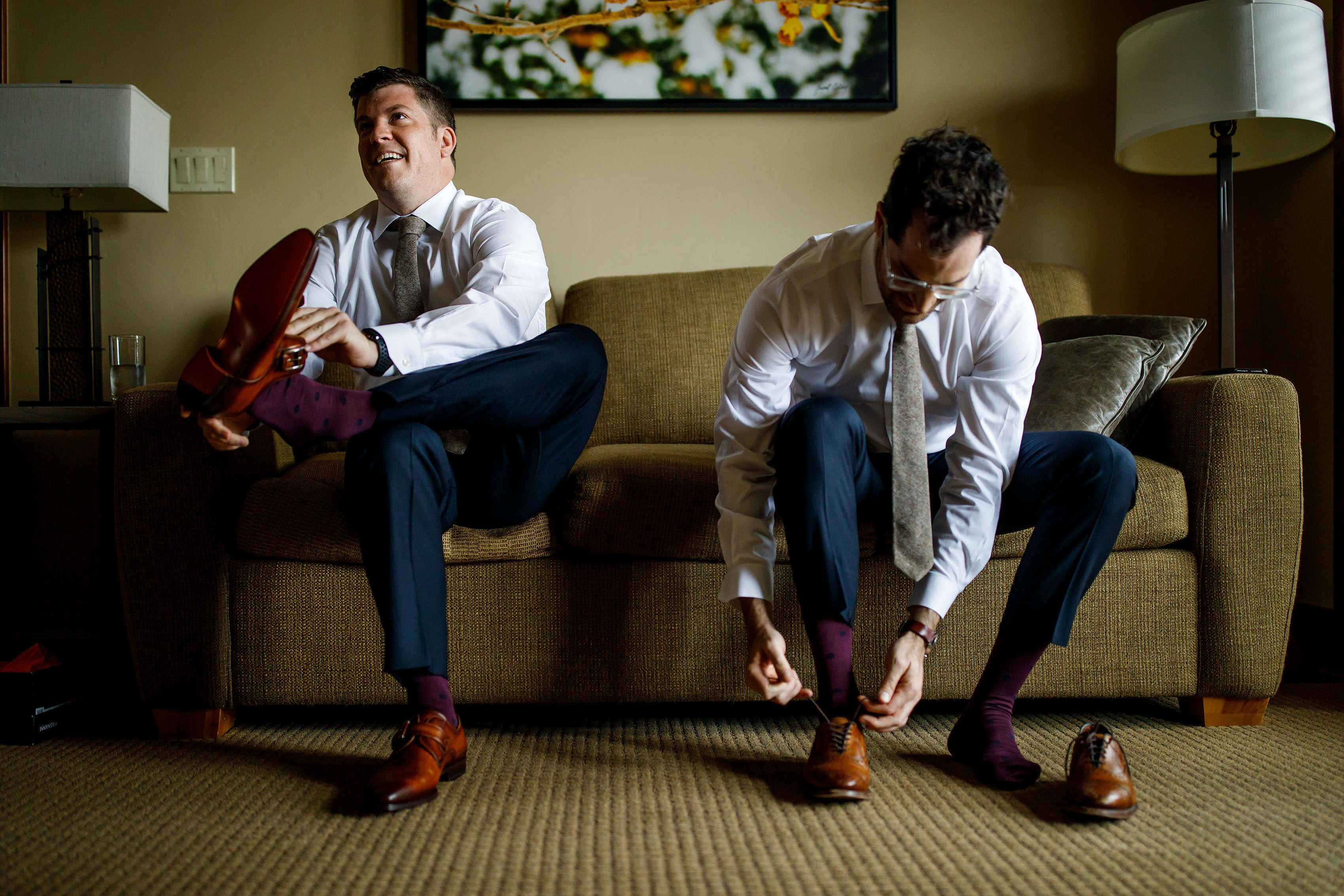 grooms put on brown shoes
