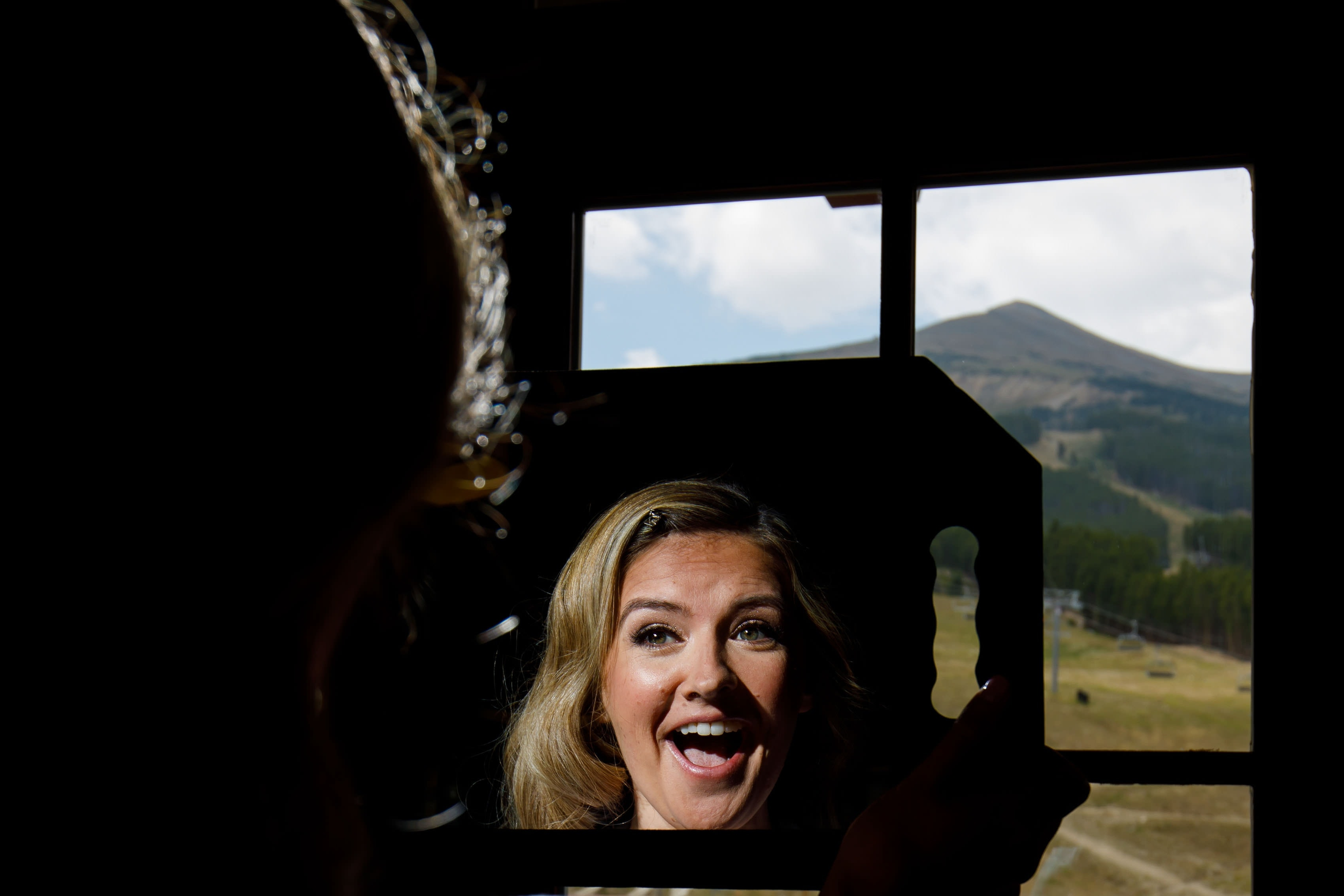 the bride reacts during makeup at One Ski Hill Place