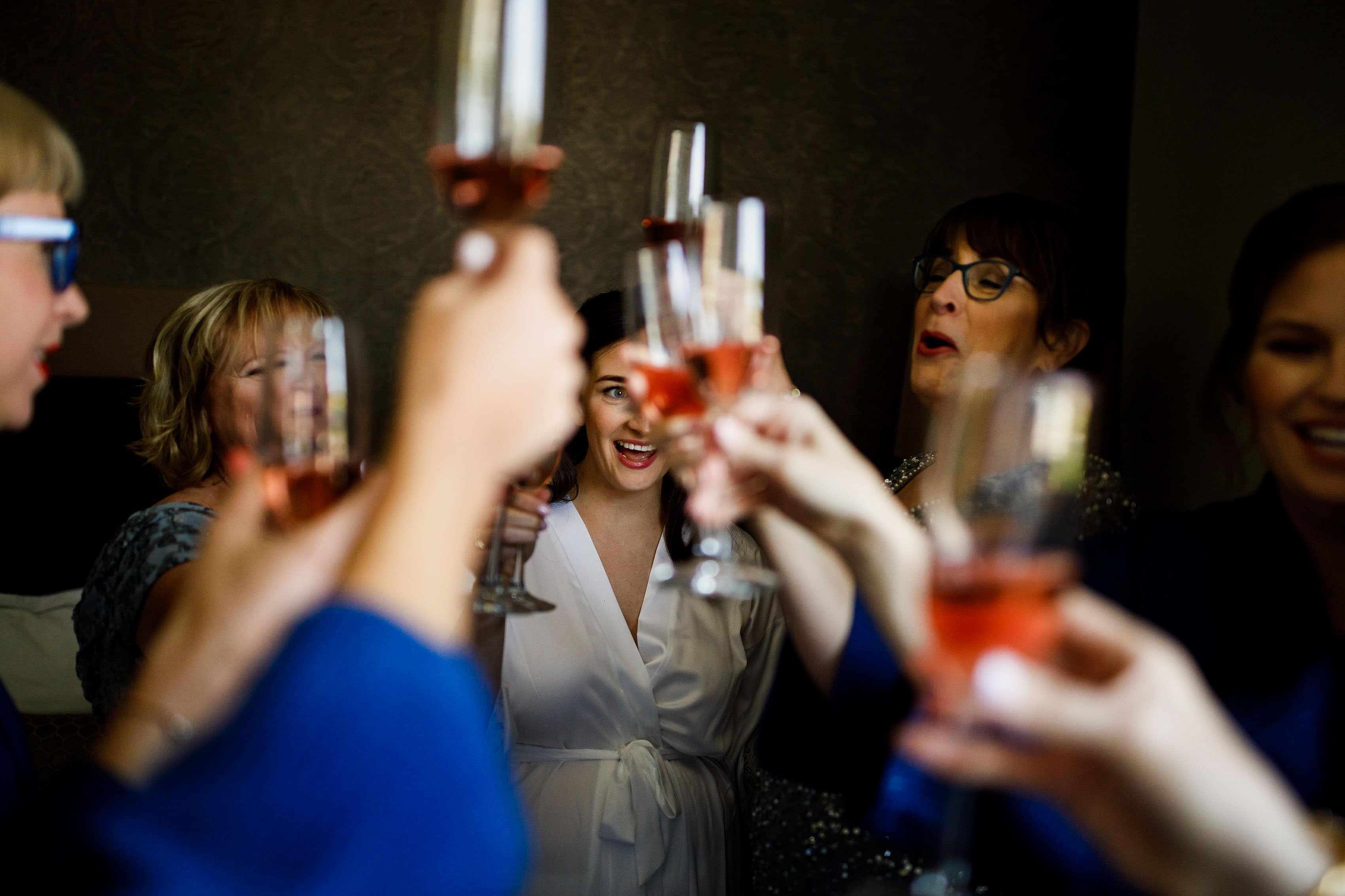 The bride toasts with bridesmaids