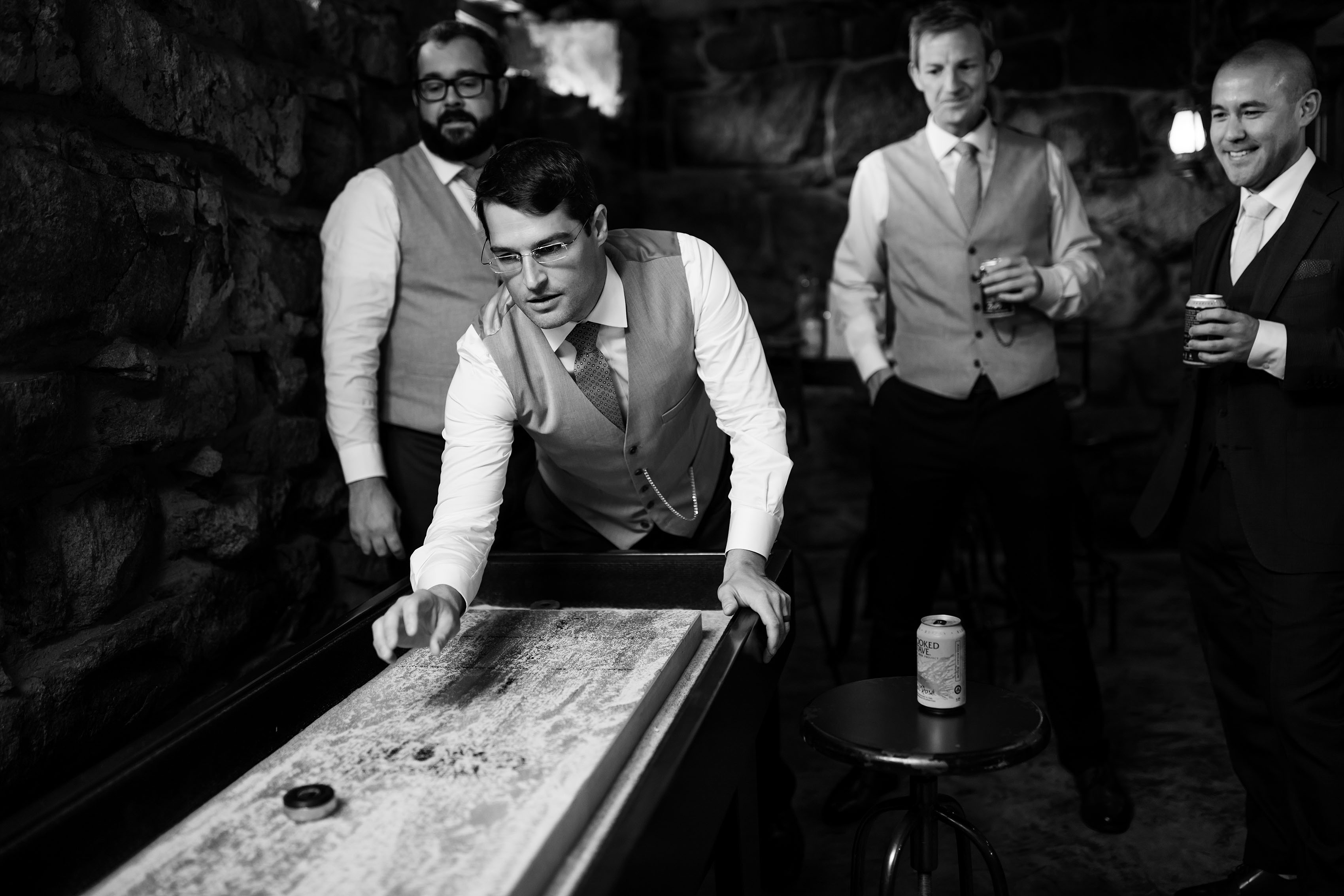 Groomsmen play shuffleboard at Deer Creek Valley Ranch
