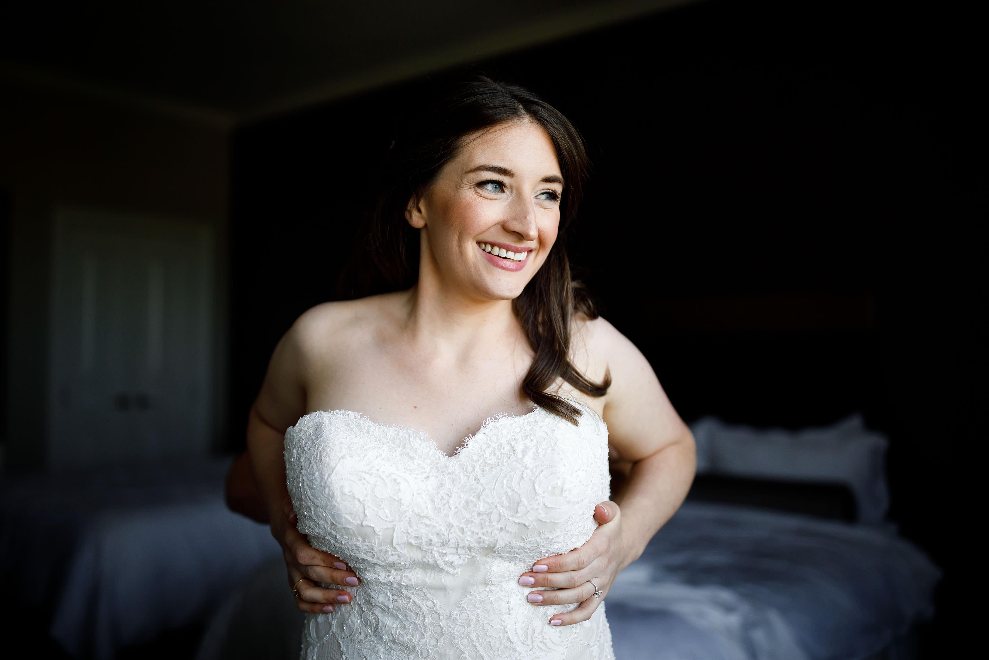 Katie puts on her gown