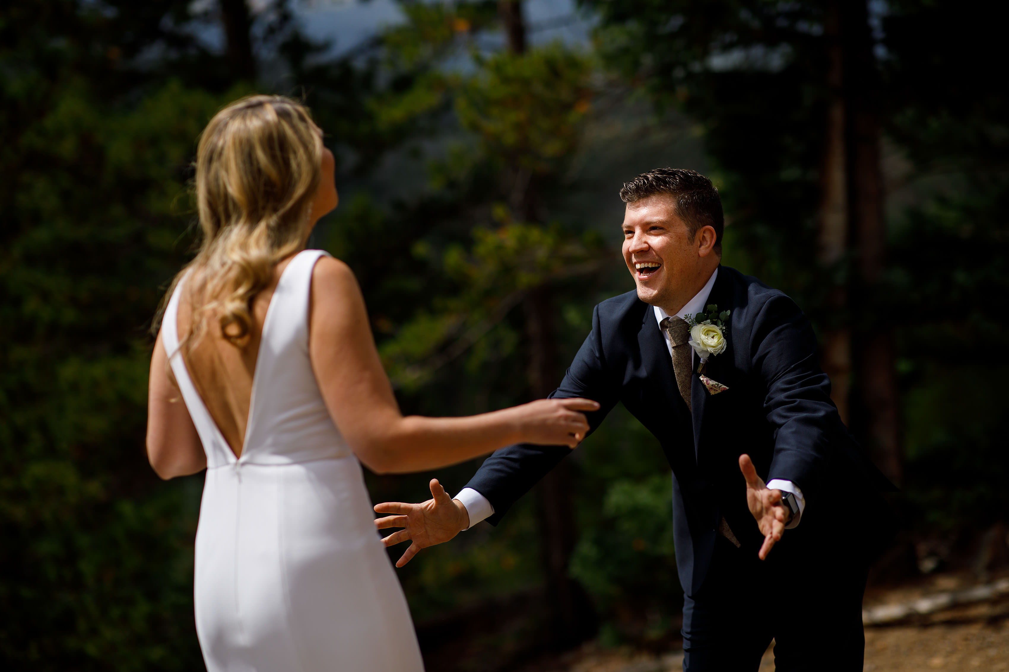 the groom reacts to seeing his bride in Breckenridge
