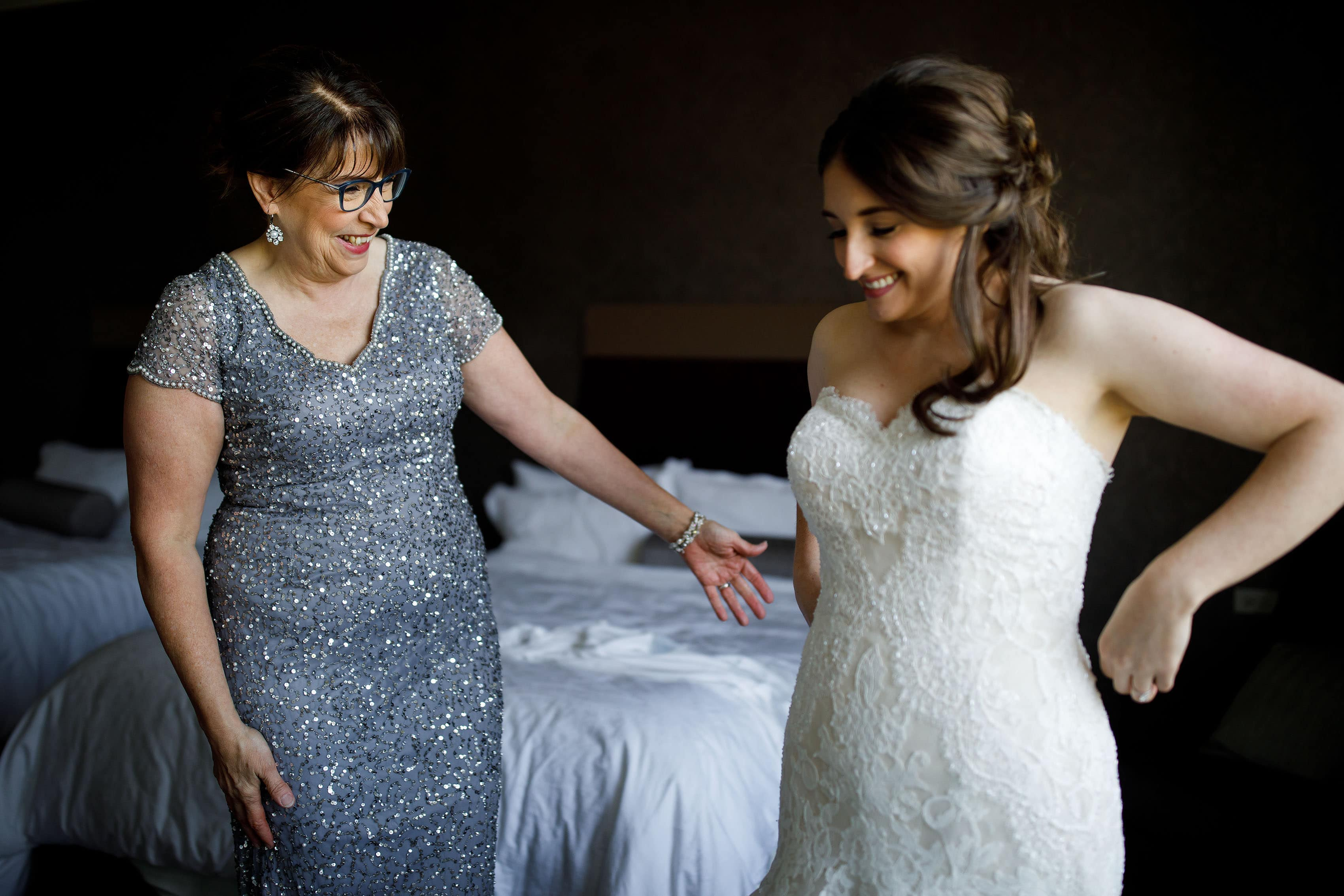 Katie and her mother share a moment after getting into her wedding gown