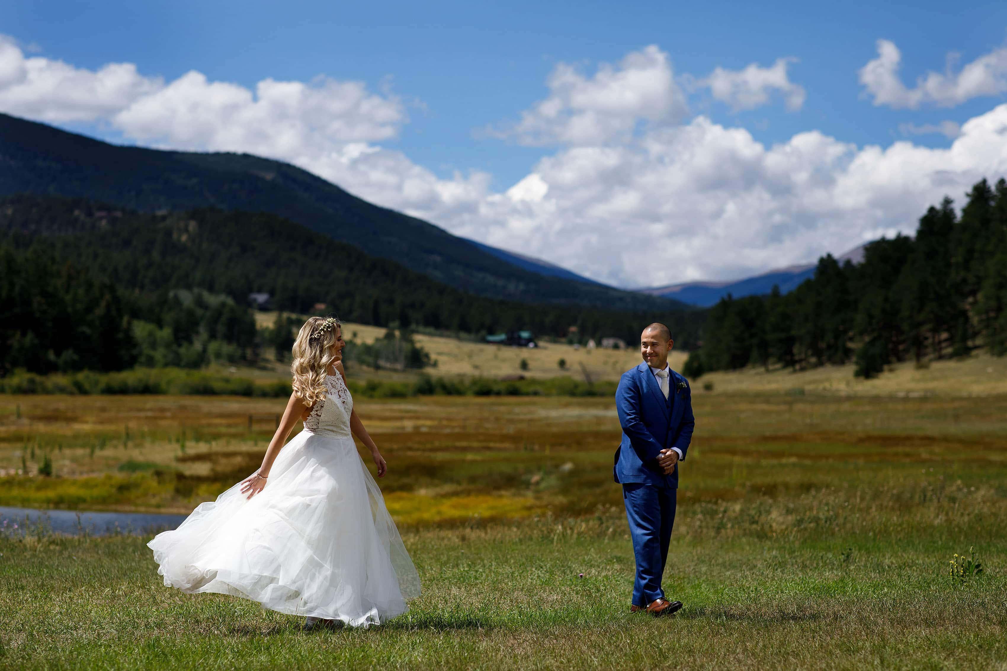 Bride and groom react during first look during their summer wedding at Deer Creek Valley Ranch