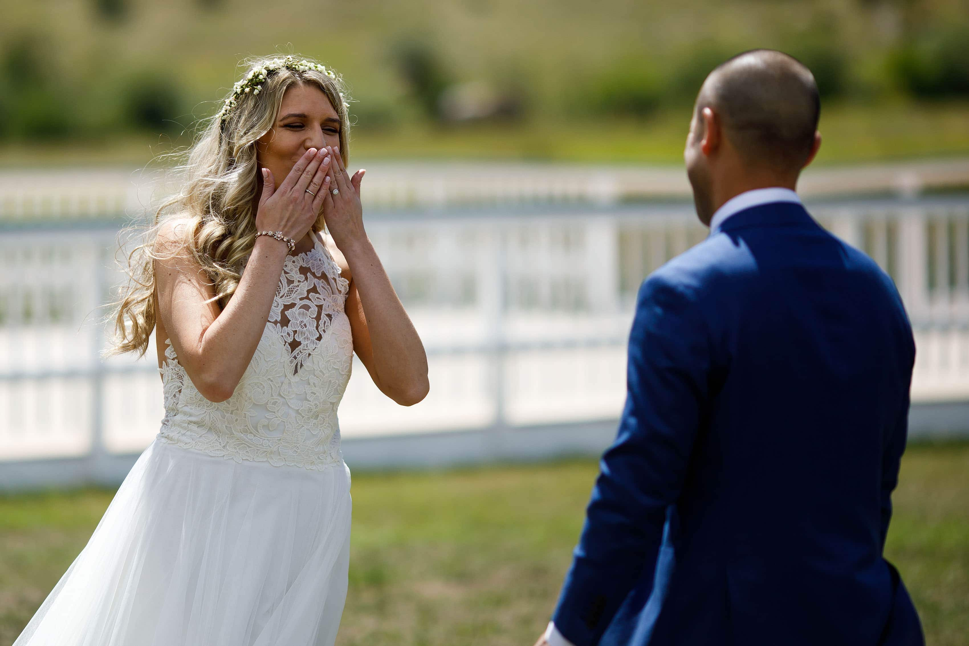 The bride reacts to seeing her groom