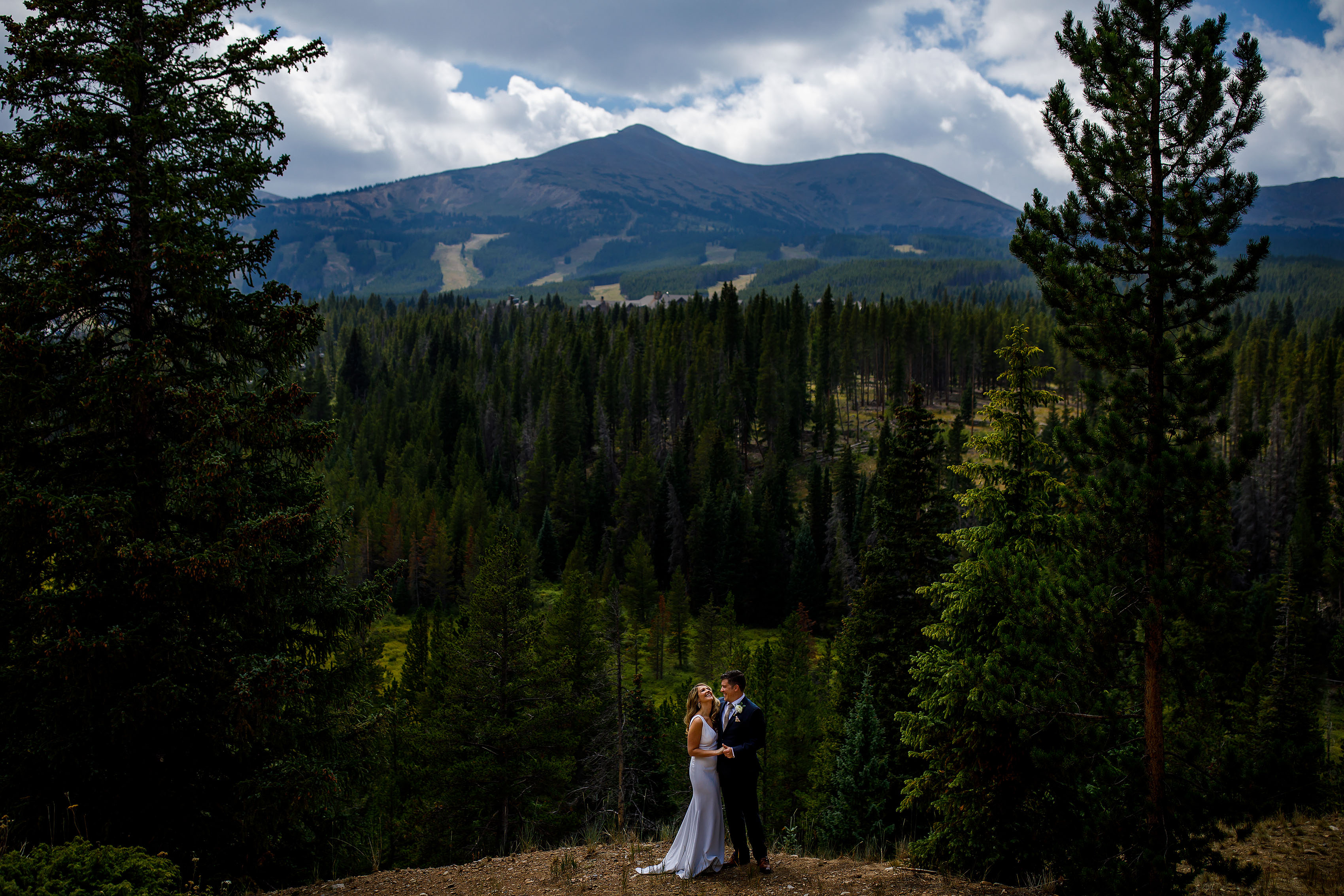 the couple pose near peak 8 at Breckenridge