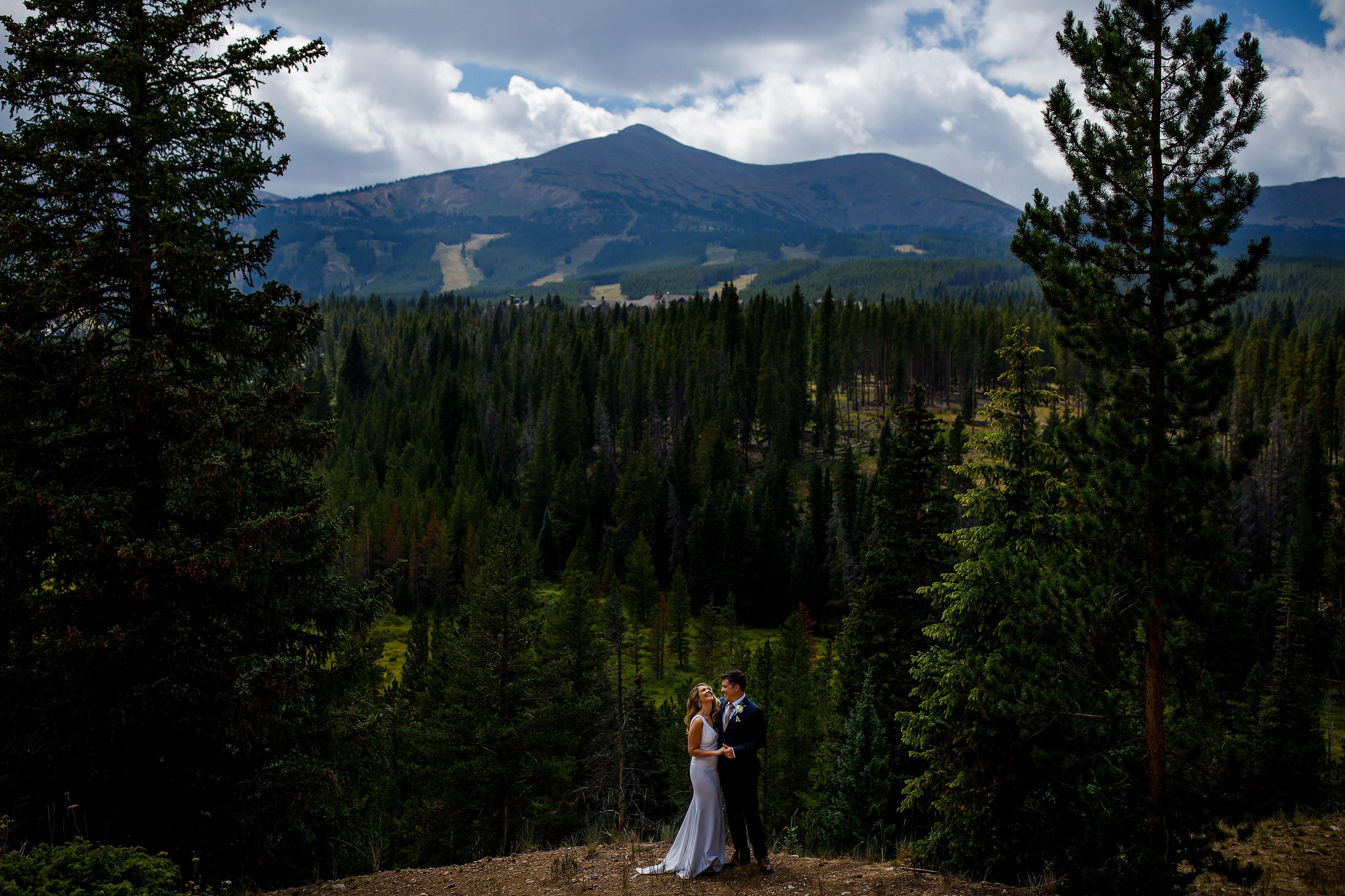 the couple pose near peak 8 at Breckenridge