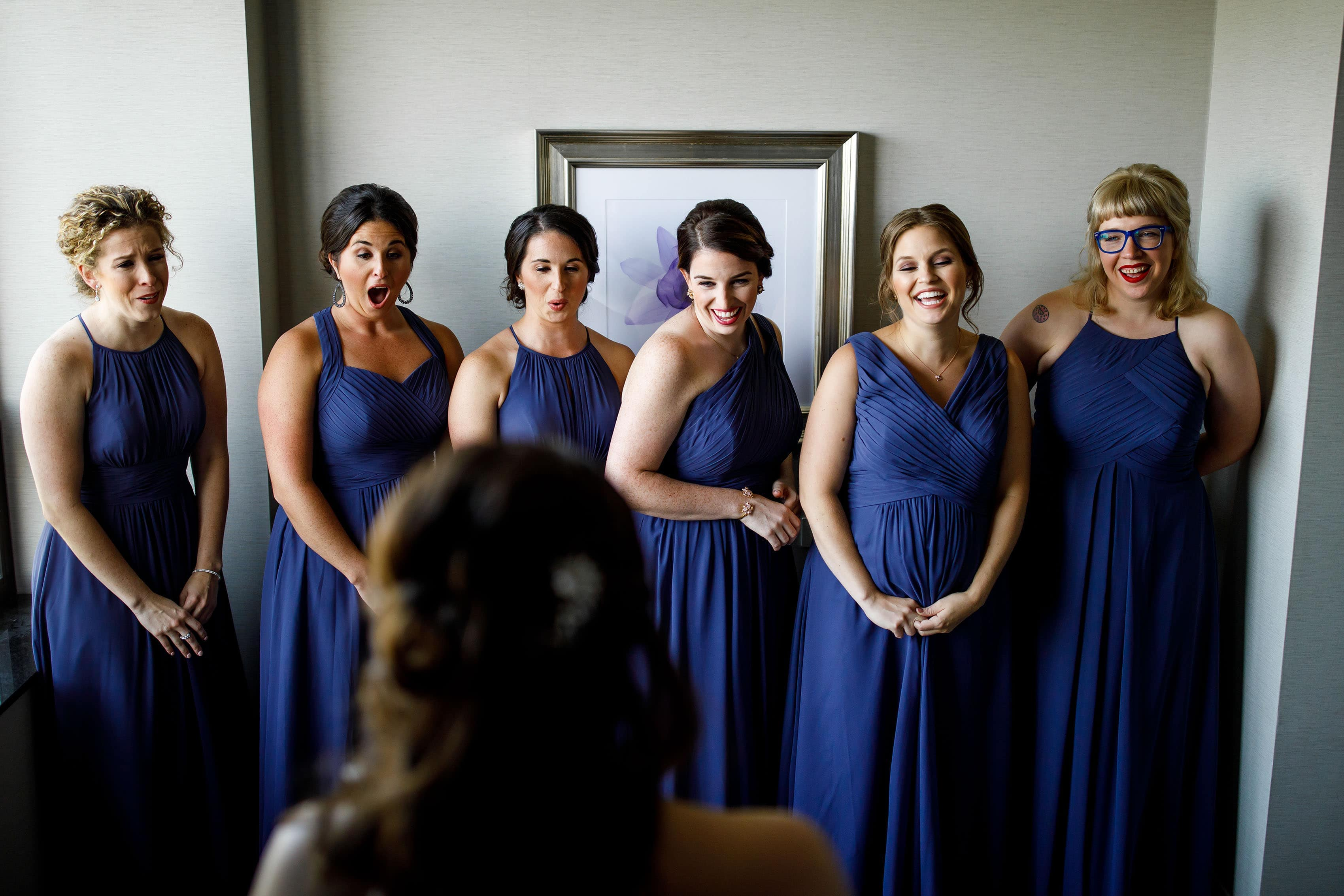 Bridesmaids react to seeing the bride at La Banque hotel