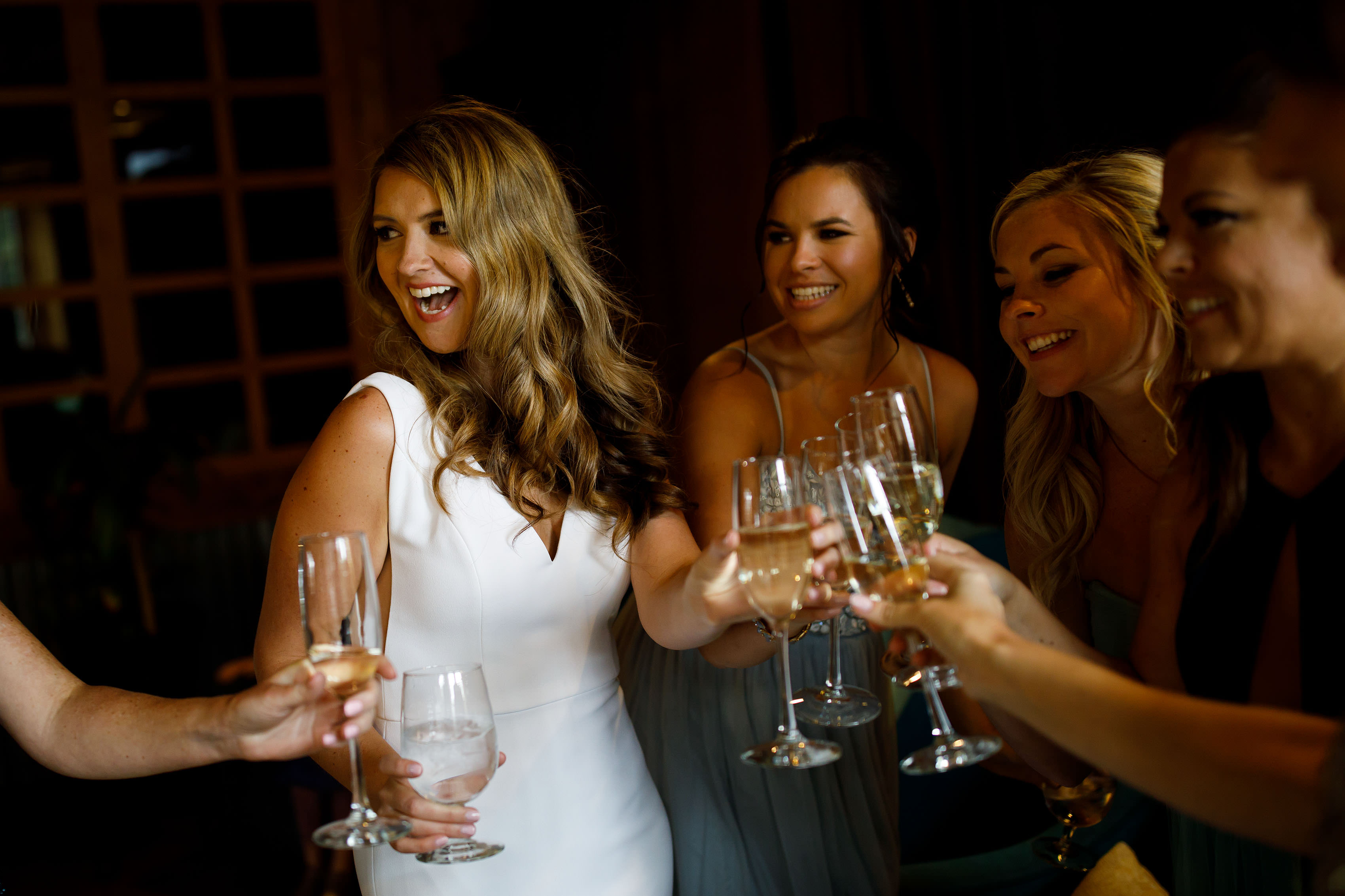 Heather toasts with bridesmaids