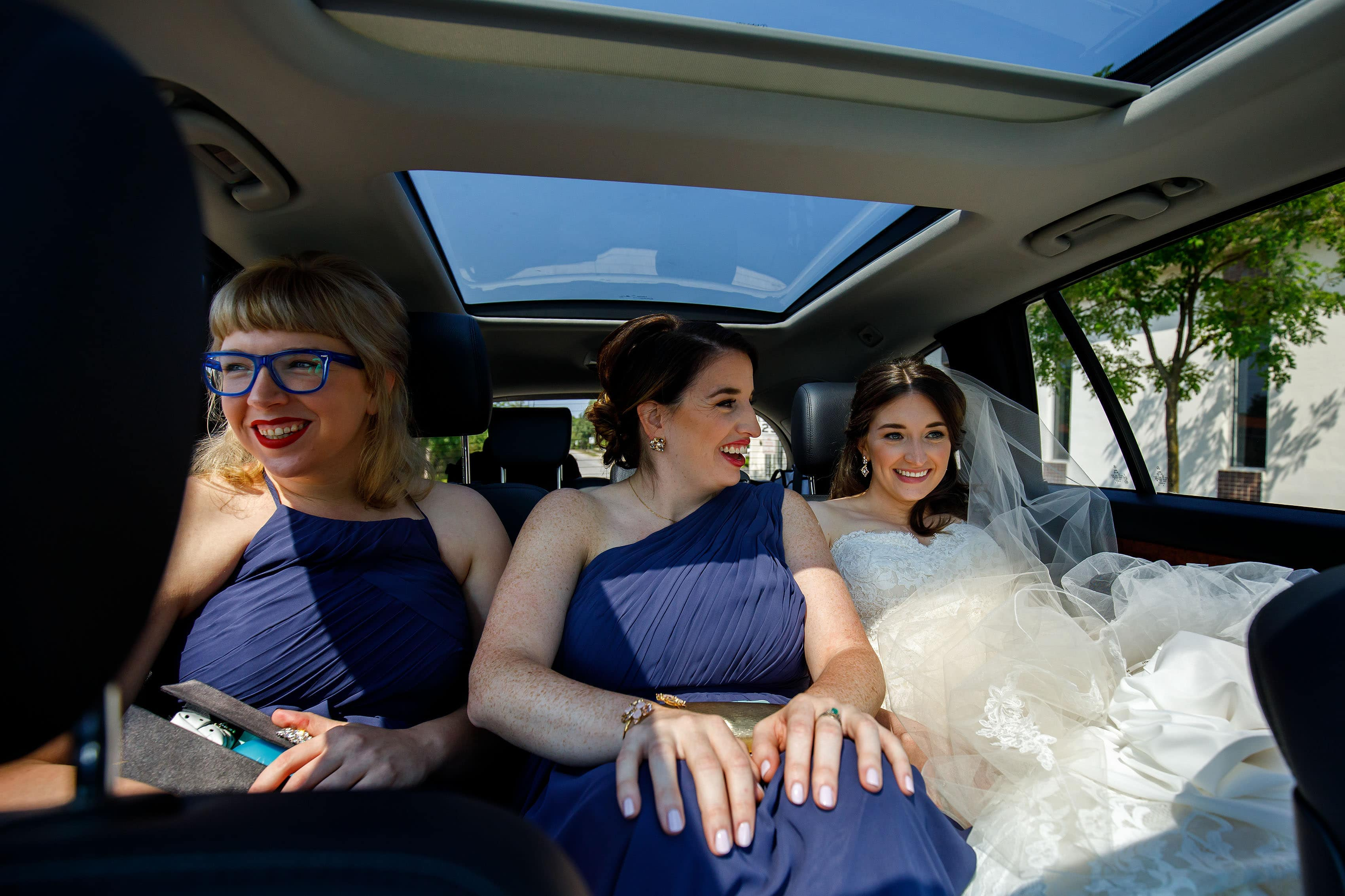 Katie rides to the wedding with her sisters