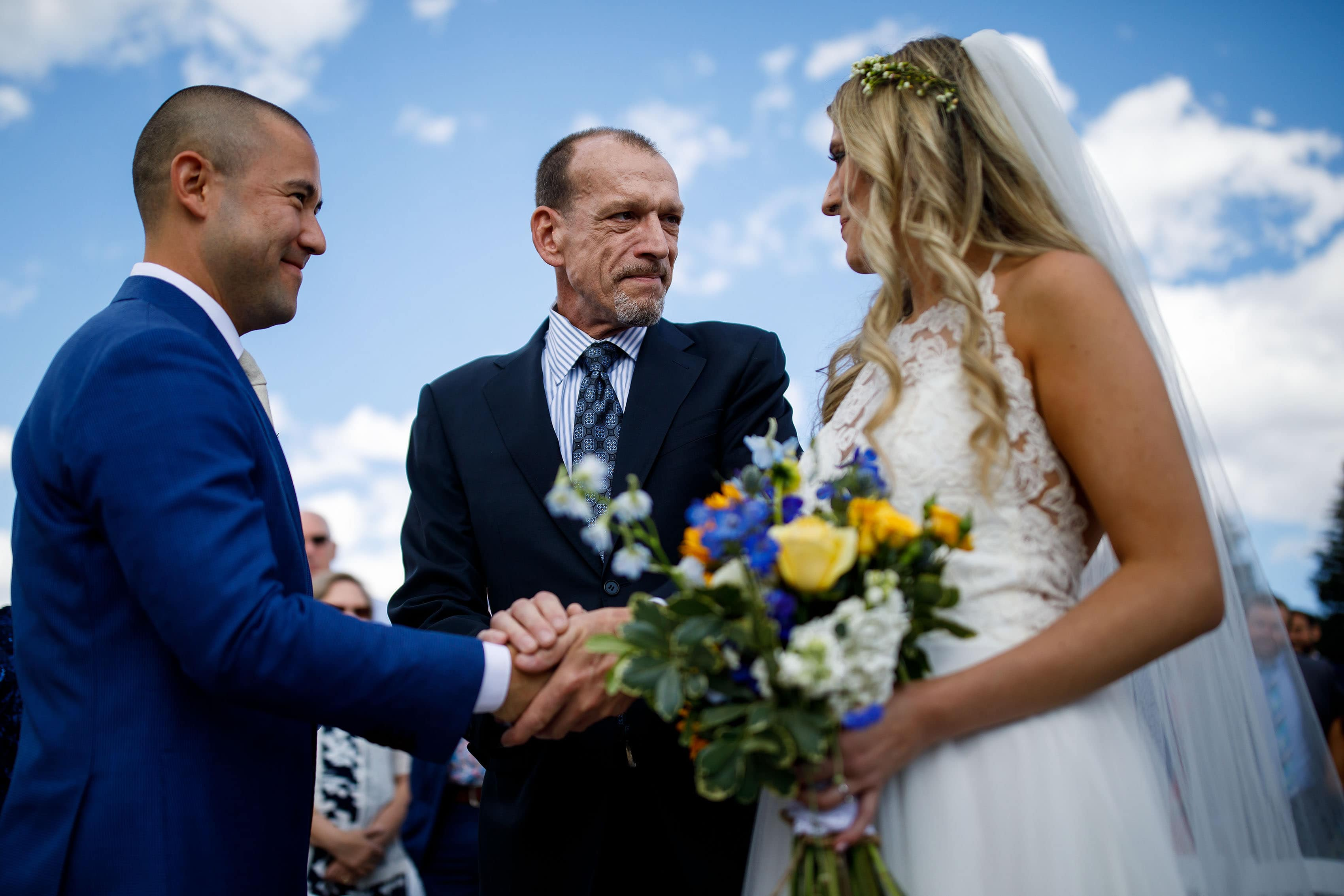 The father of the bride gives away his daughter at Deer Creek Valley Ranch