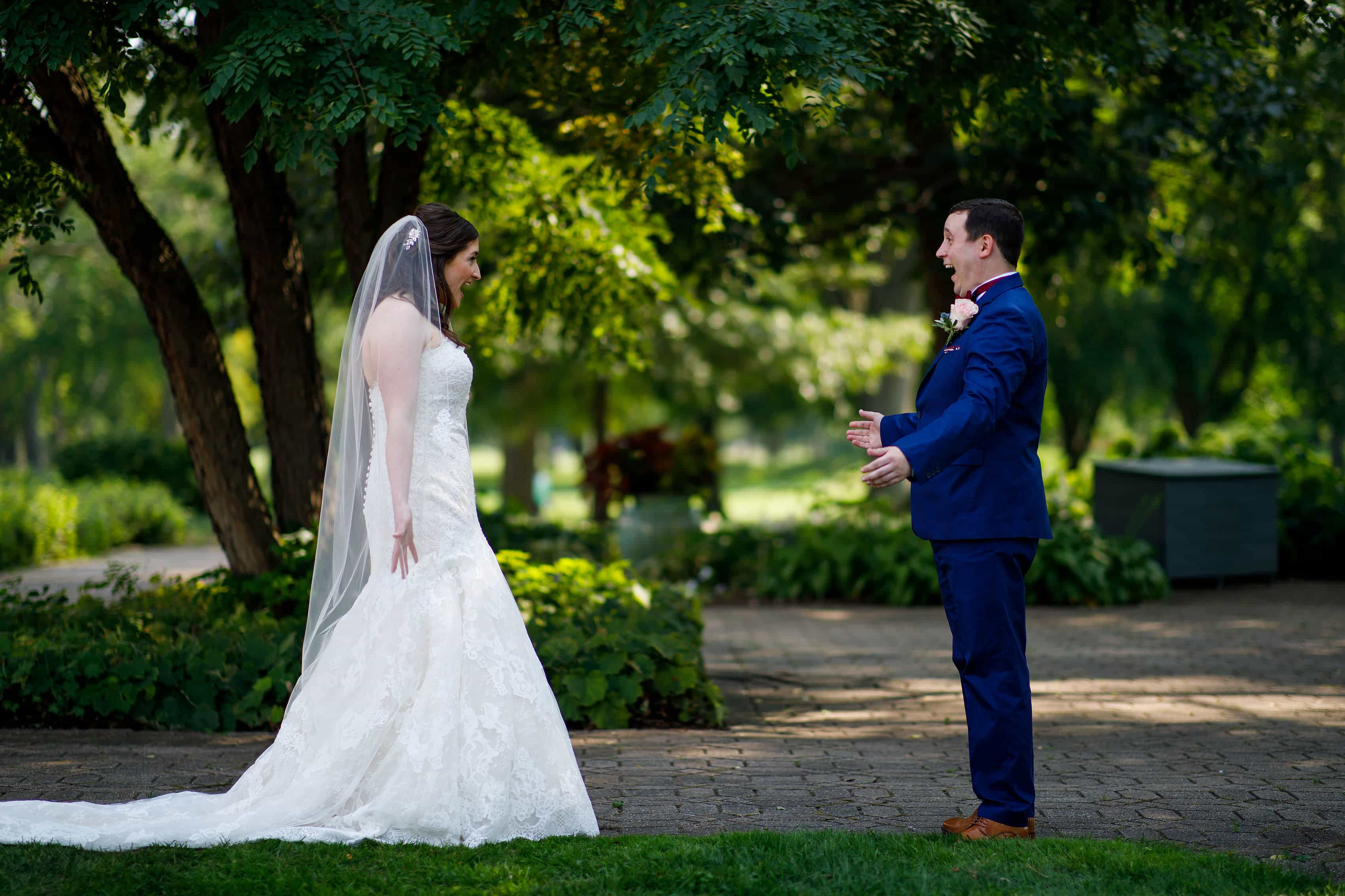 Katie and Joel react during their first look at Ravisloe Country Club