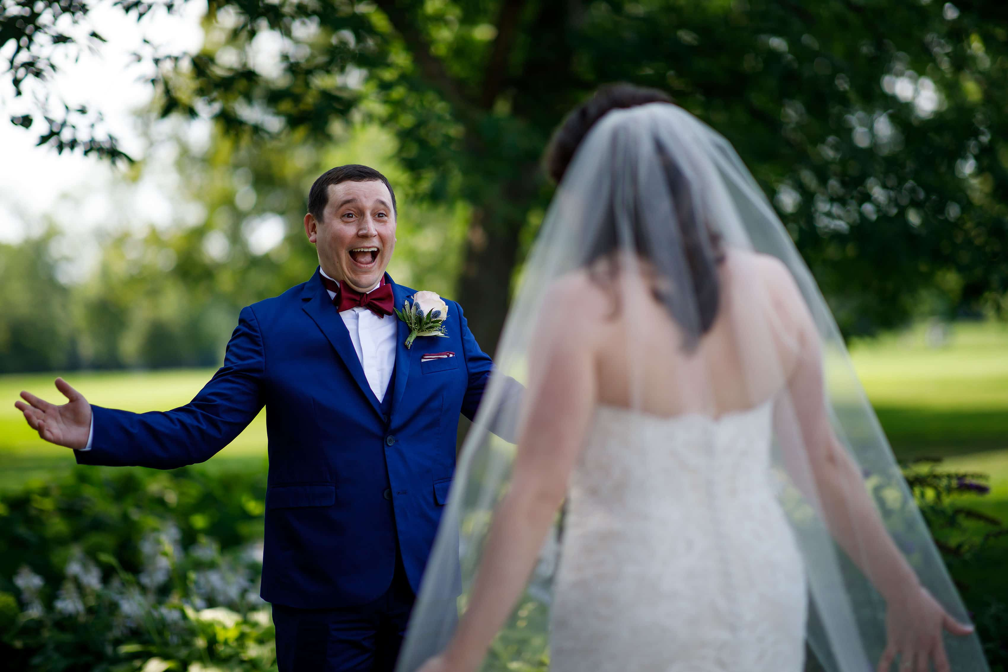 Joel reacts to seeing his bride during their first look at Ravisloe Country Club