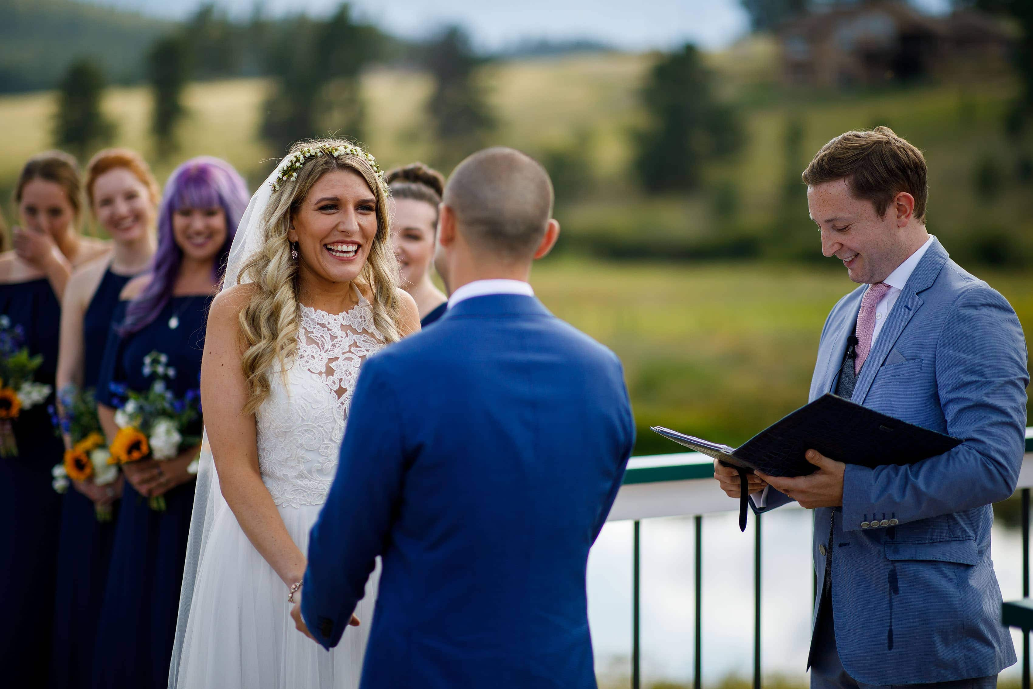 The bride smiles at Deer Creek Valley Ranch