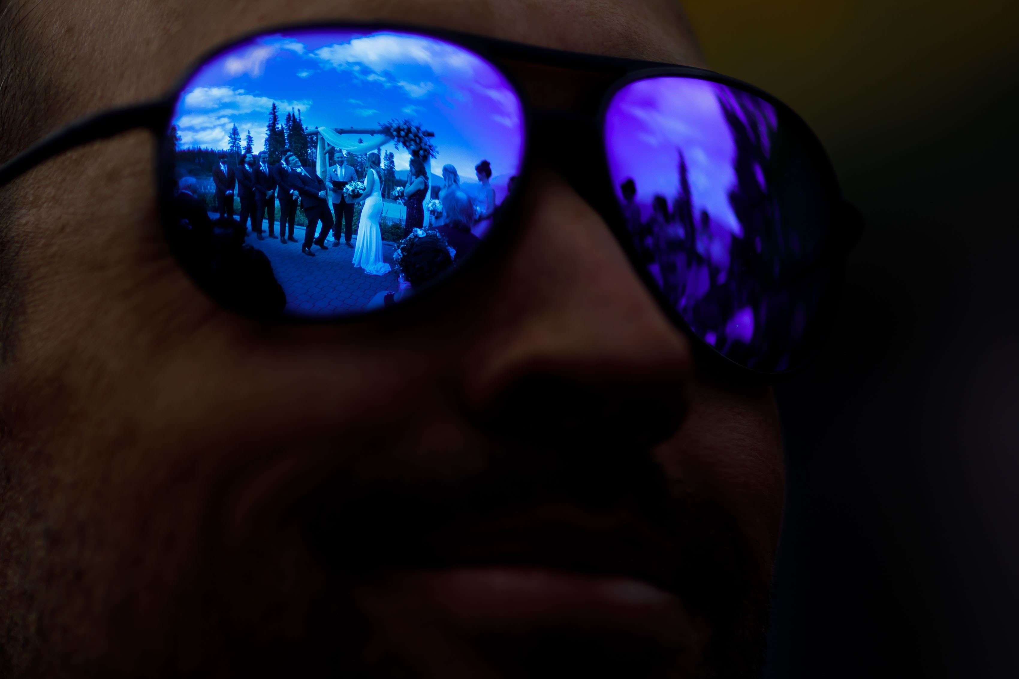 The ceremony is reflected in a guests sunglasses at TenMile