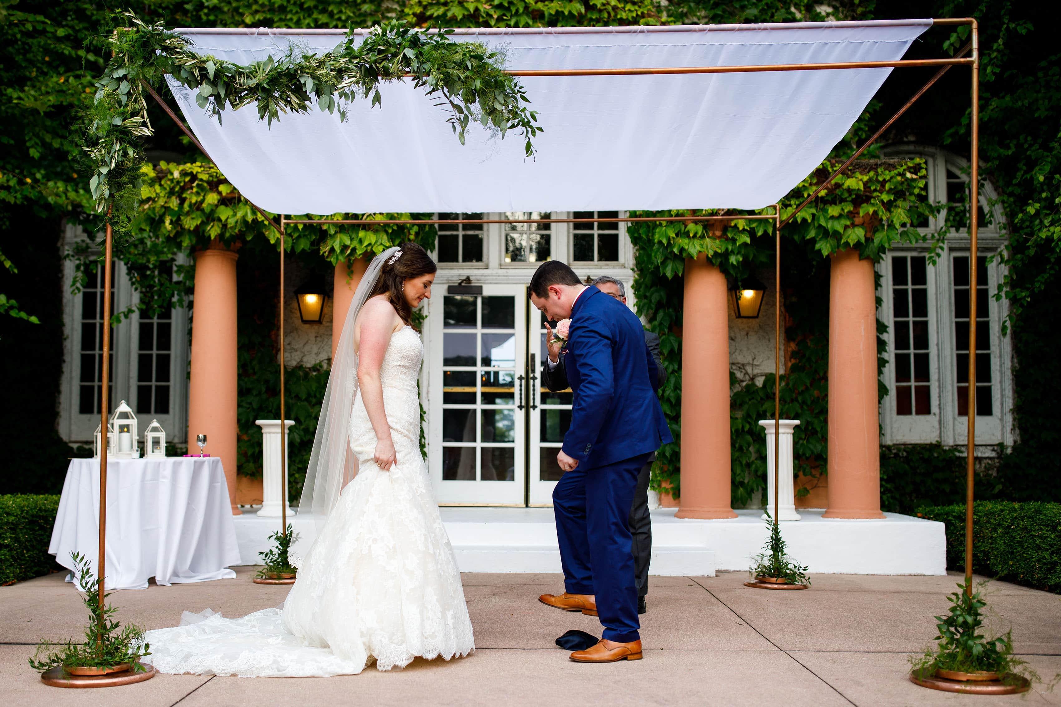 Joel breaks a glass under the chuppah during their Ravisloe Country Club wedding