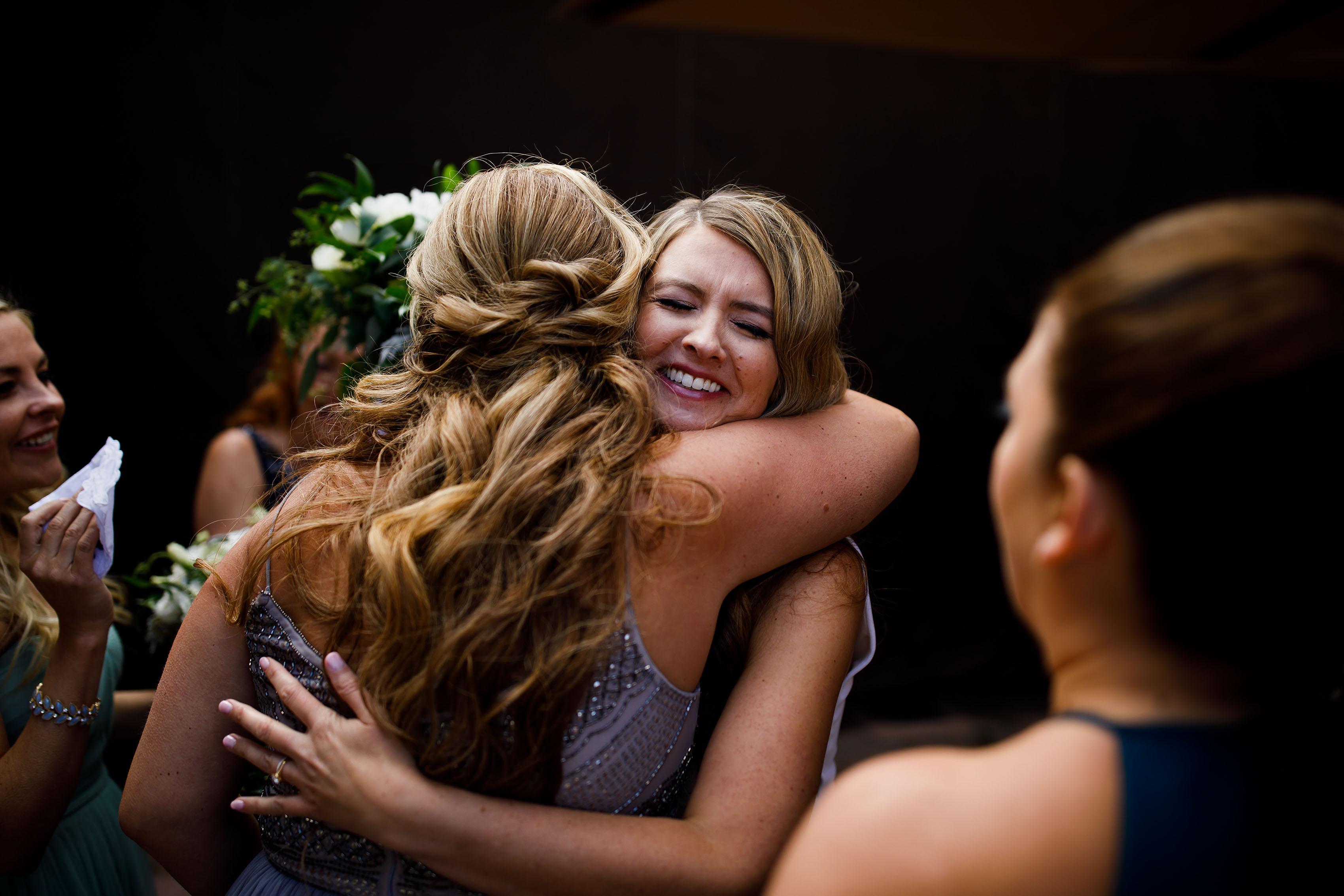 Heather hugs her bridesmaids