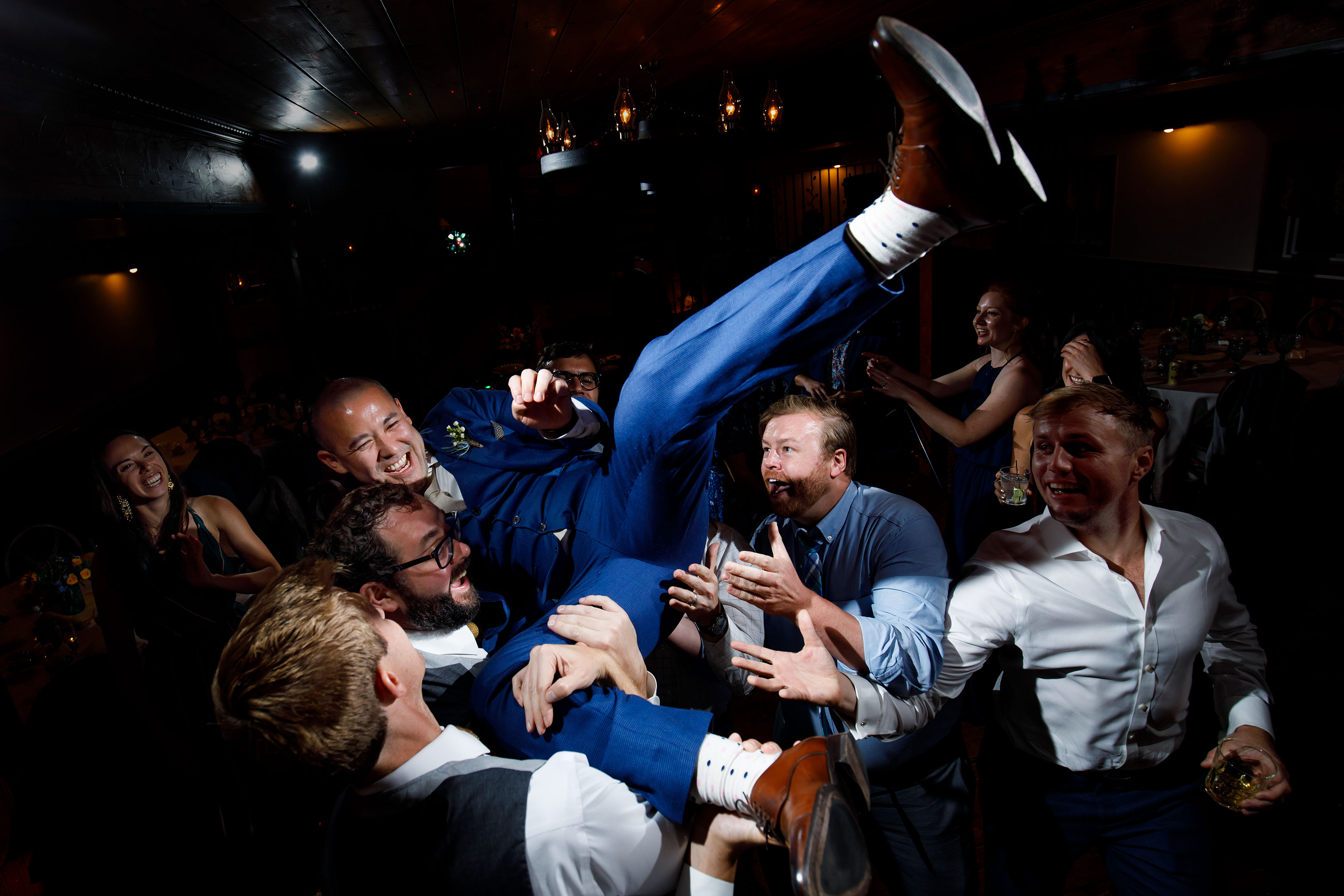 The groom is lifted in the air during a dance party at Deer Creek Valley Ranch