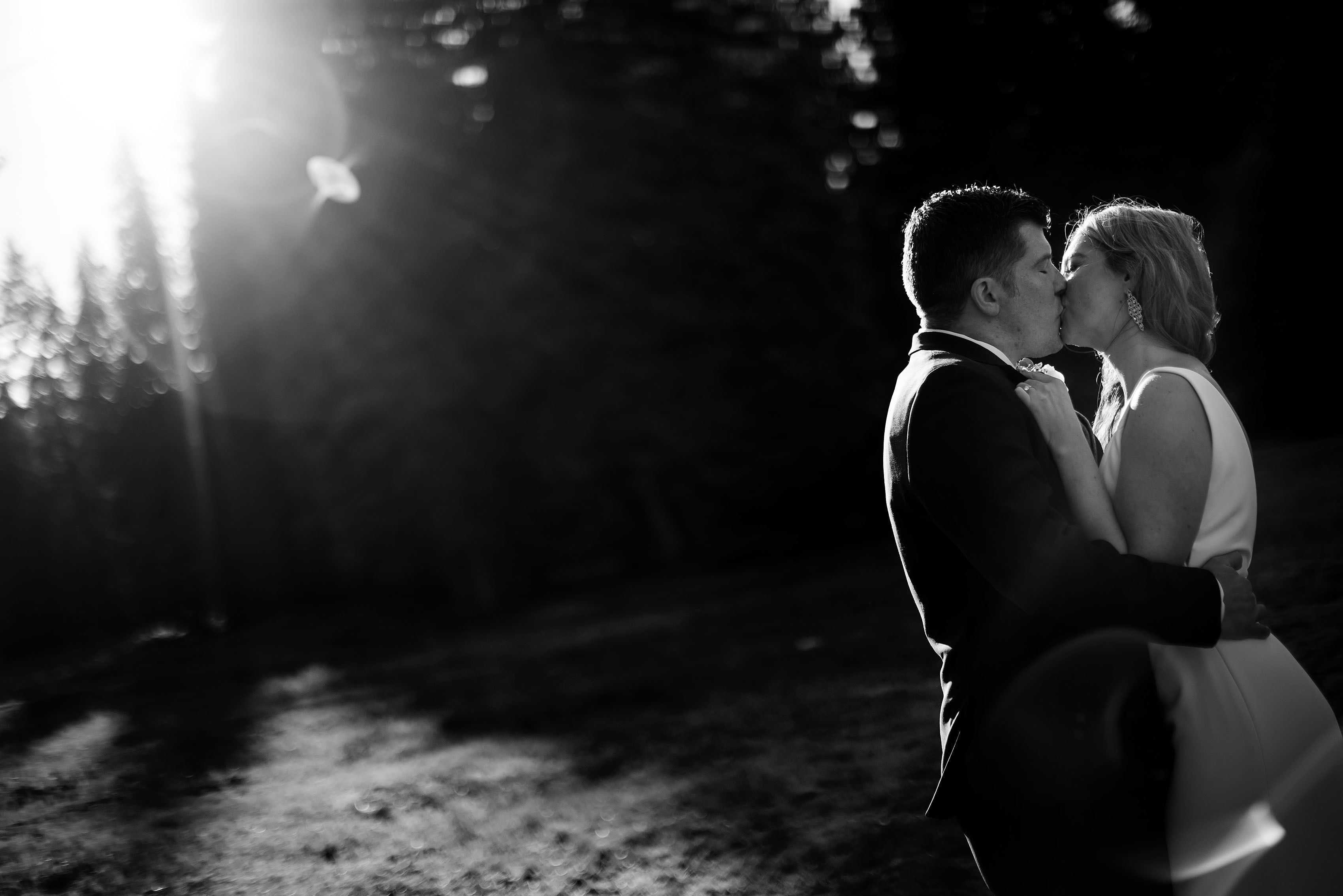 the couple kiss at TenMile during their portraits