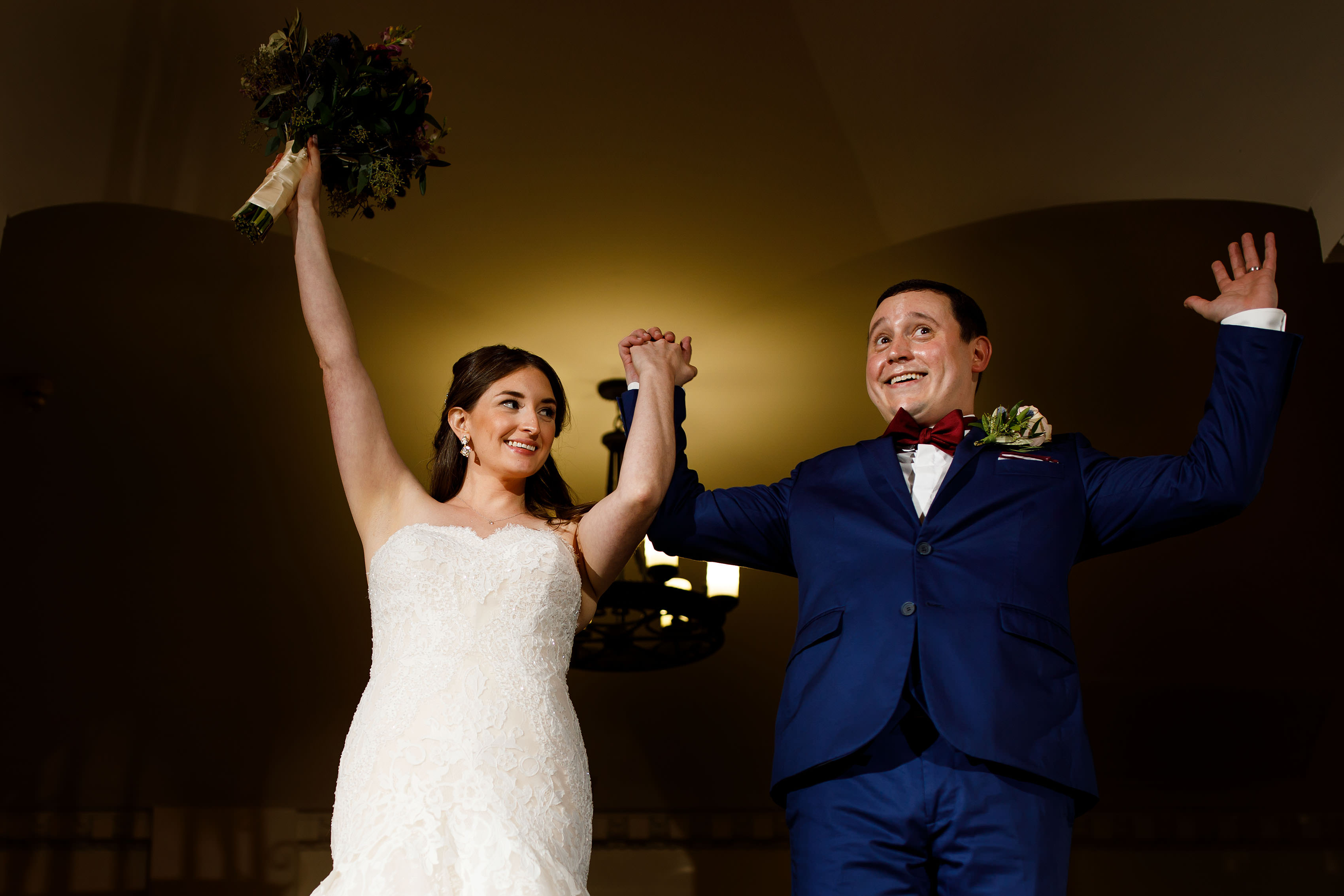 The couple celebrate during their entrance