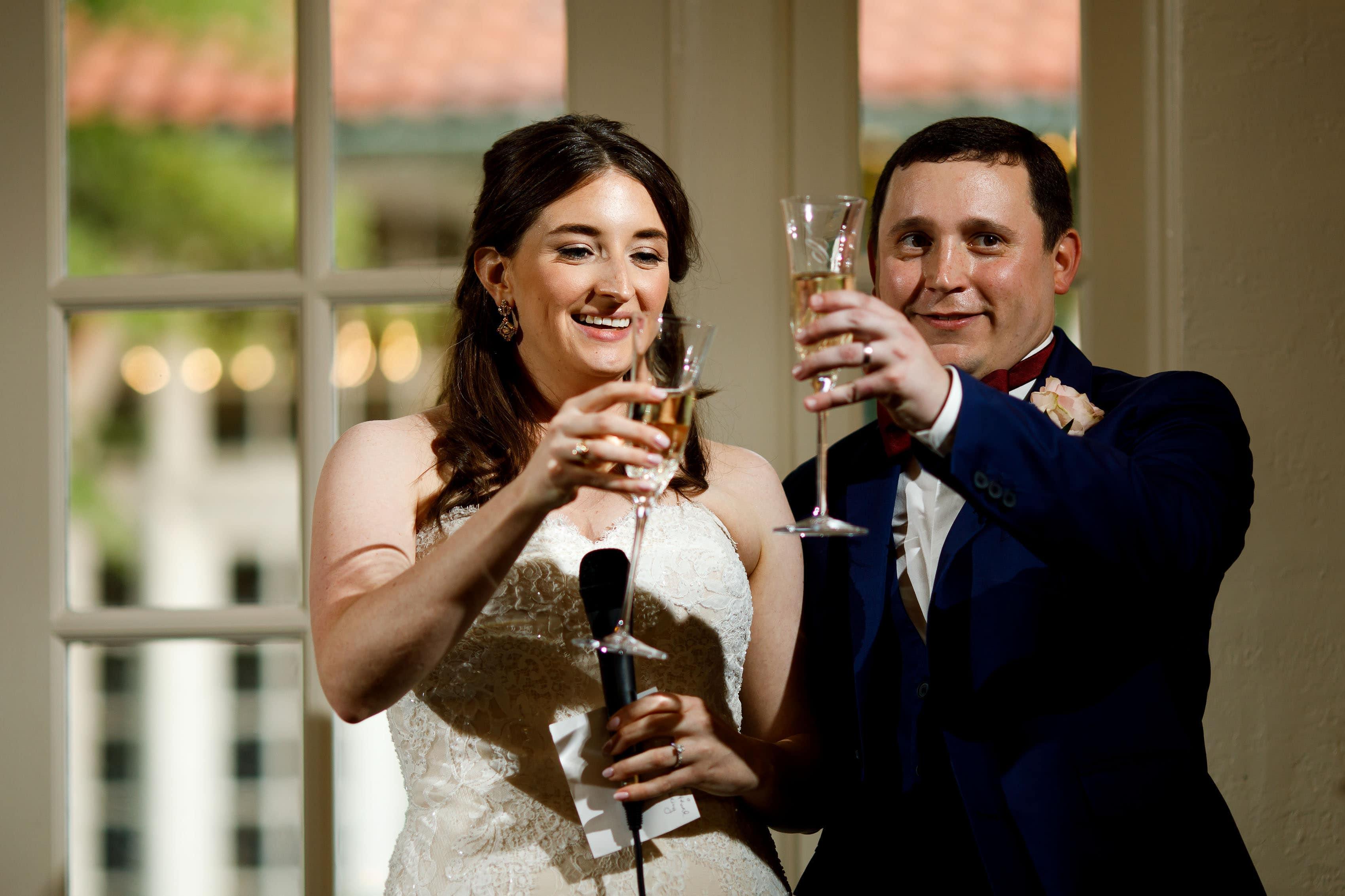 The bride and groom toast at Ravisloe