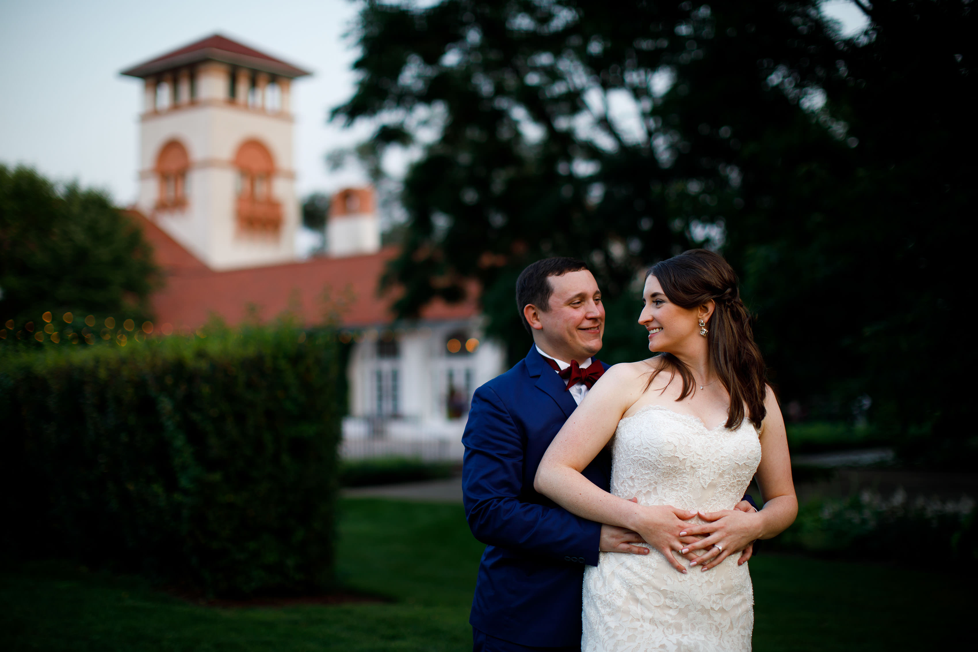The newleyweds pose for a portrait during their Ravisloe Country Club wedding in Homewood Illinois