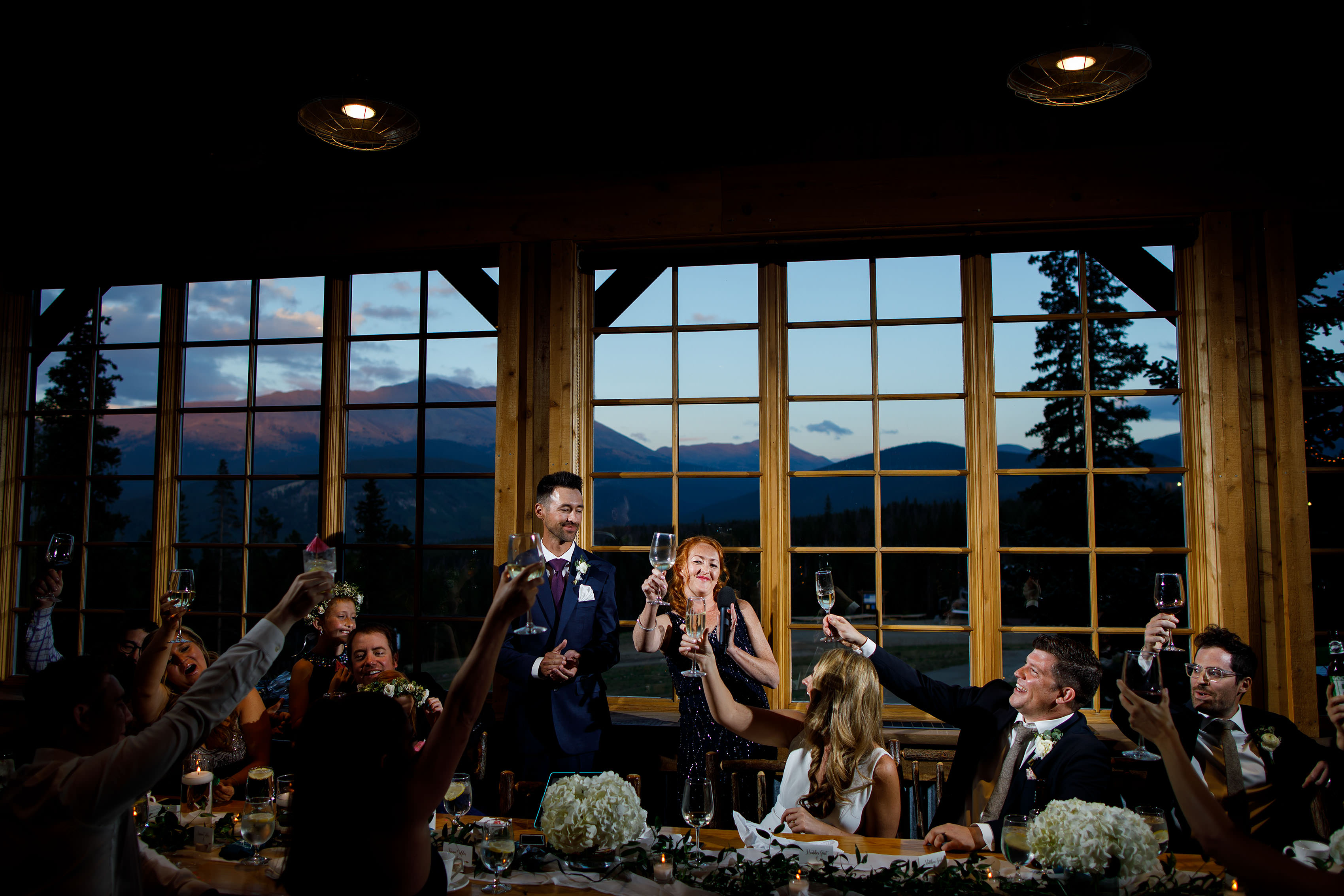 The maid of honor gives a toast during the wedding at TenMile Staion in Breckenridge